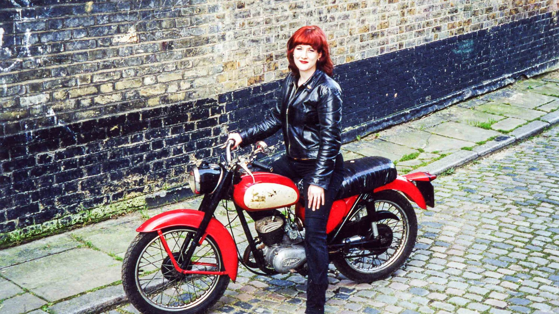 Lois poses with her first ever motorcycle.