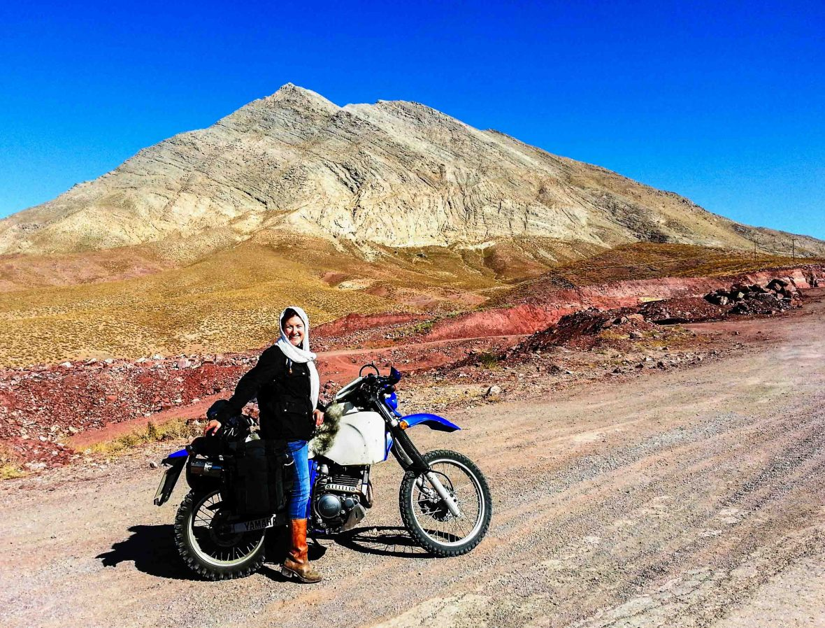 Lois by her bike in the desert mountains of Iran.
