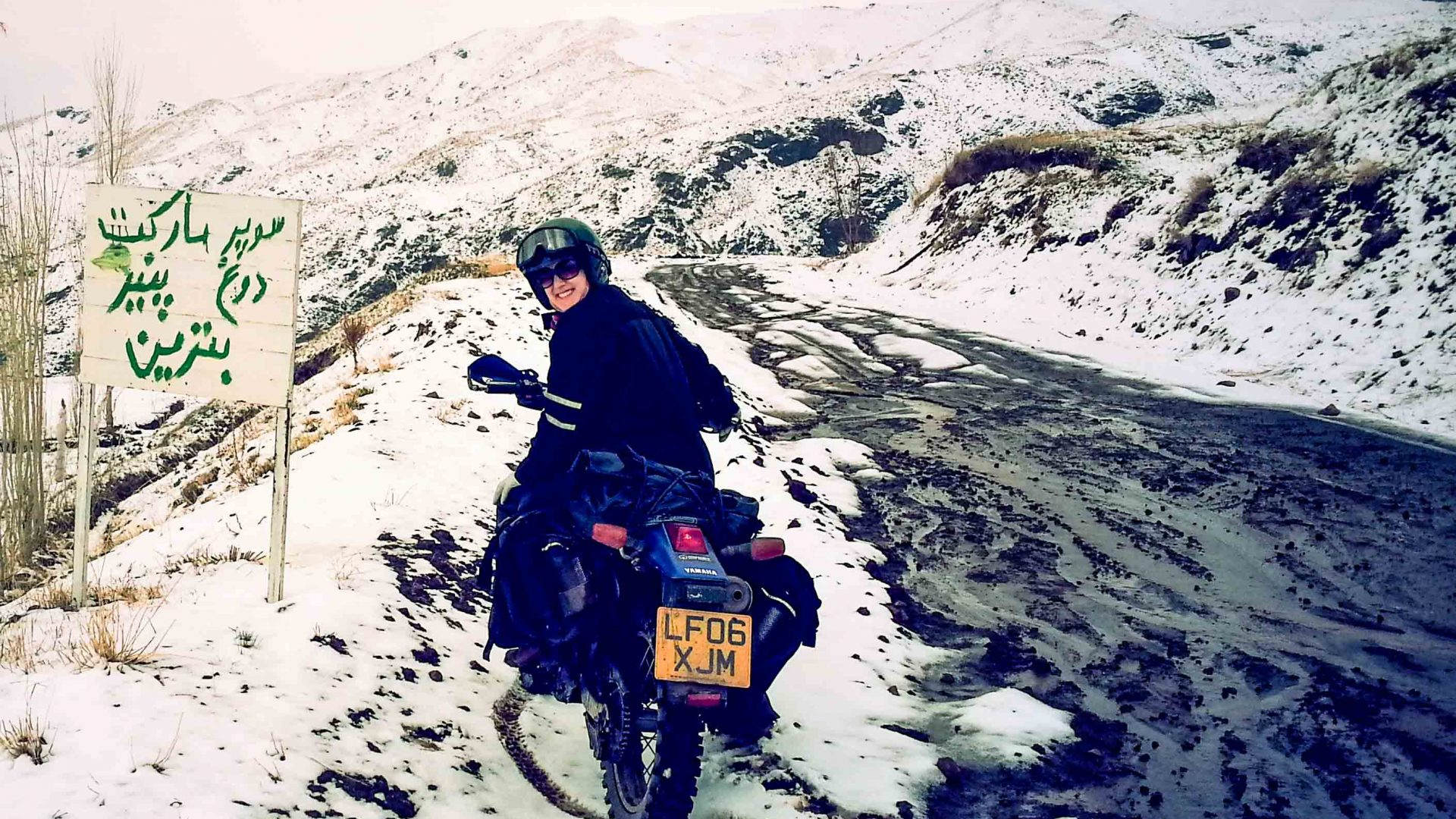 Lois rides her bike through the snow in Iran.