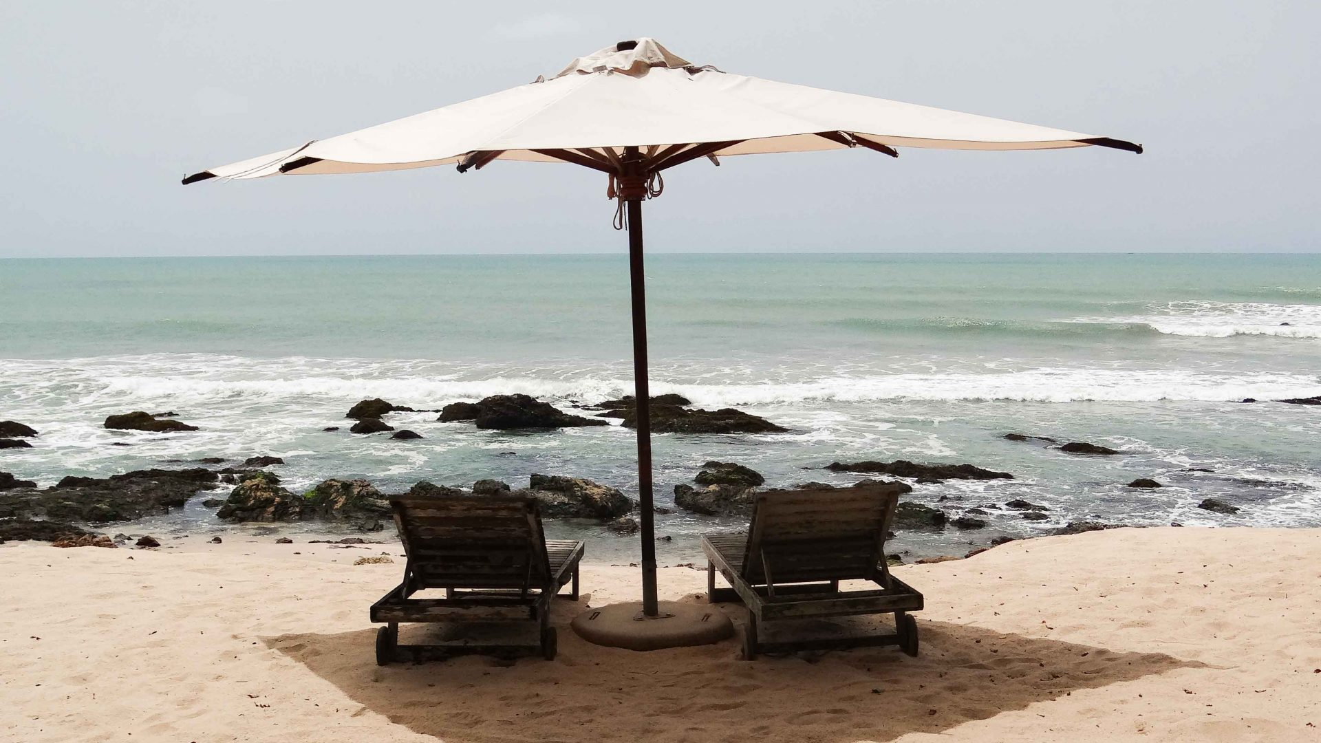 Beach chairs overlook the water in Ghana.