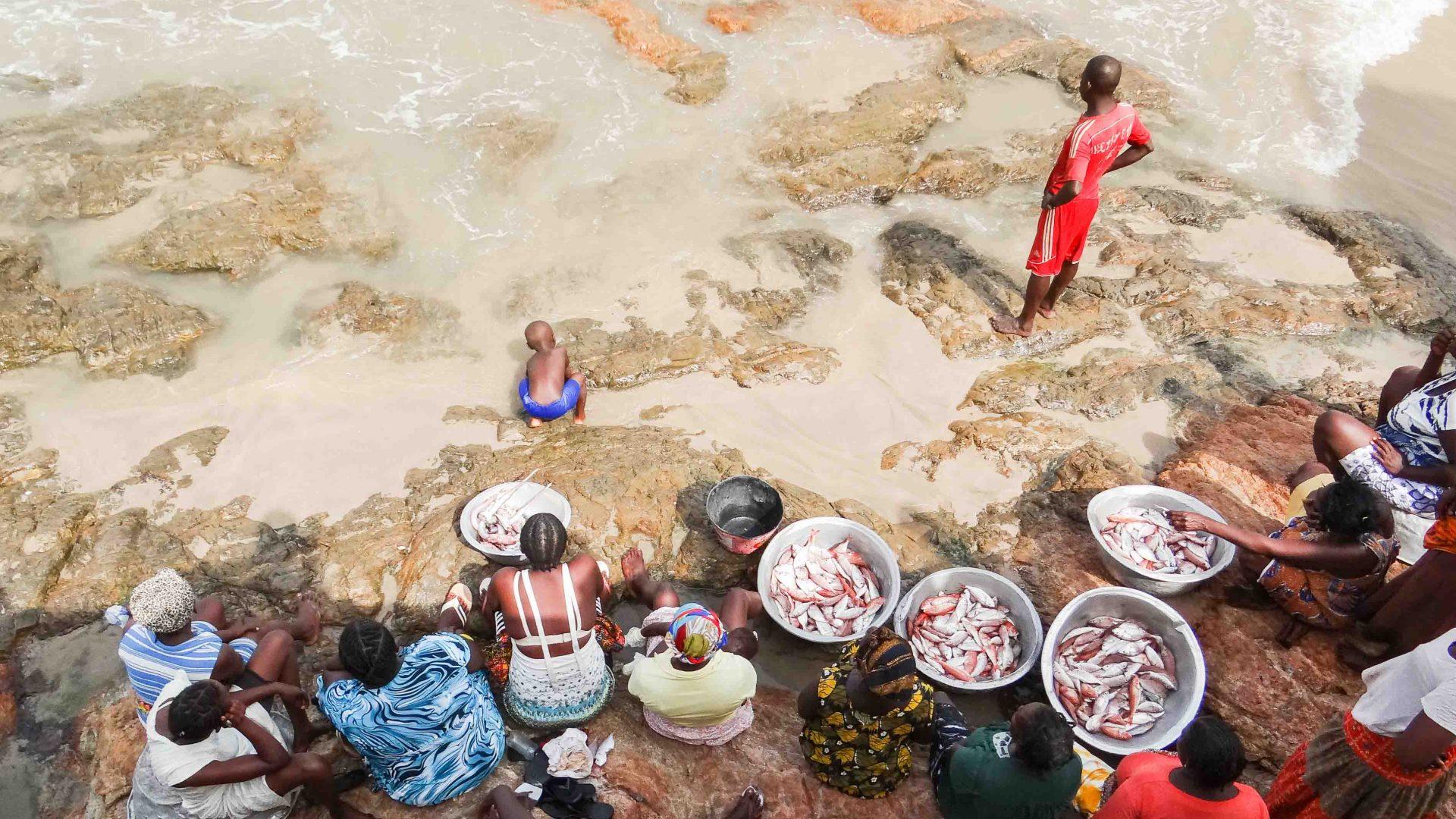 Fish dealers on the beach in Ghana.