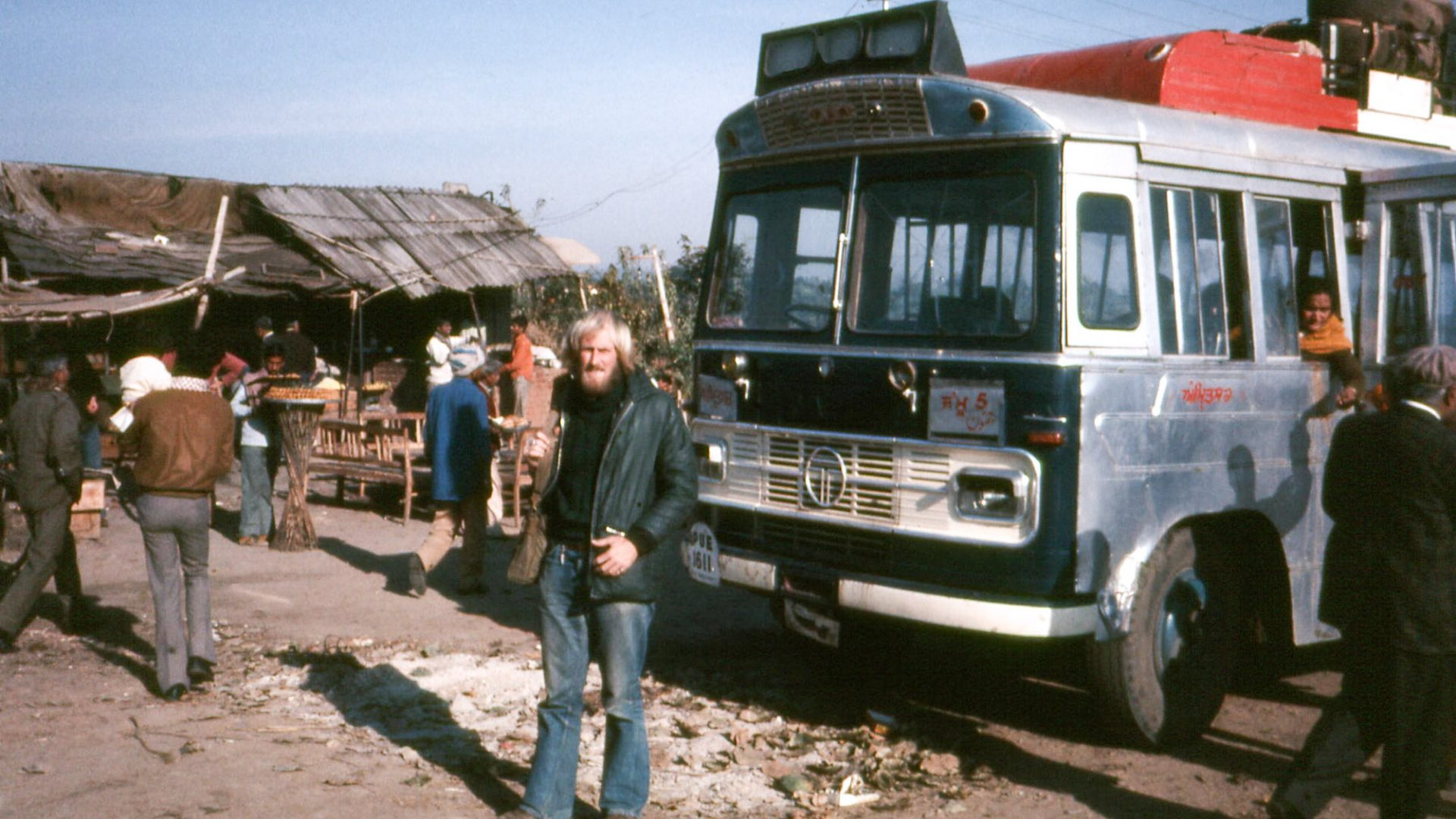 Traveling to India on the overland route in the 70's, the bus takes a break at a roadside stall.