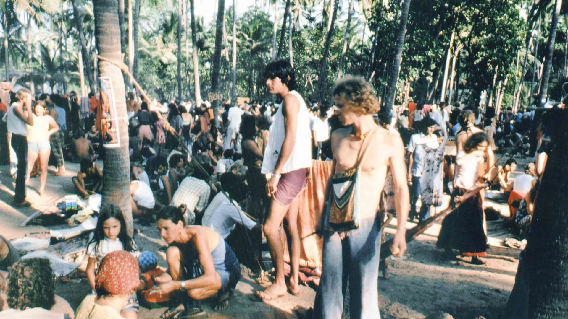Travelers at the weekly Anjuna Market in Goa, India.