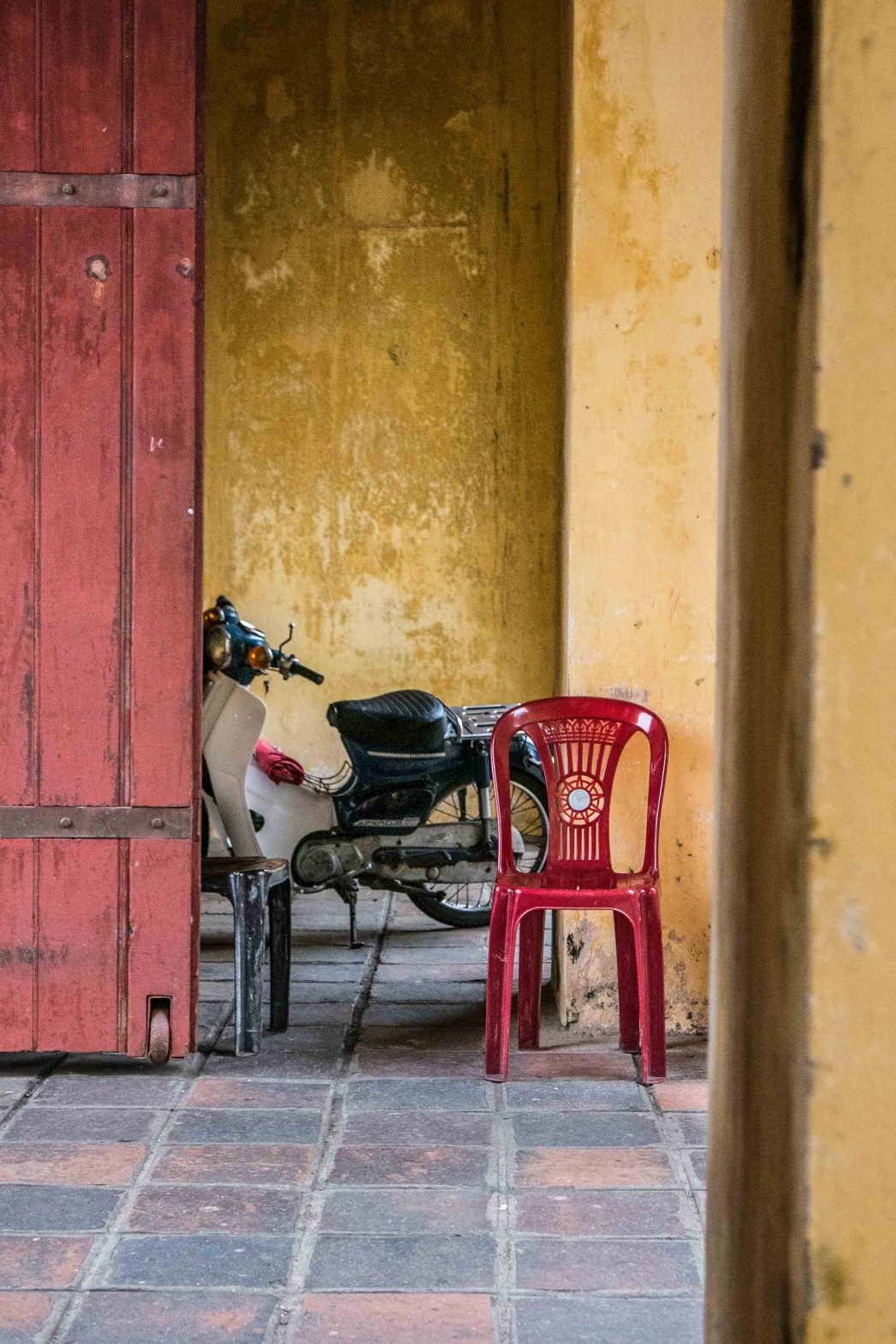Plastic chairs of Southeast Asia: One of the entrances to the Citadel in the royal town of Hue, Vietnam.