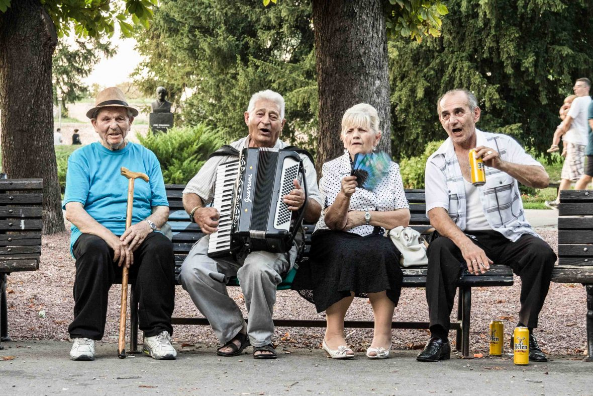 Locals in Serbia spend time in the town park.