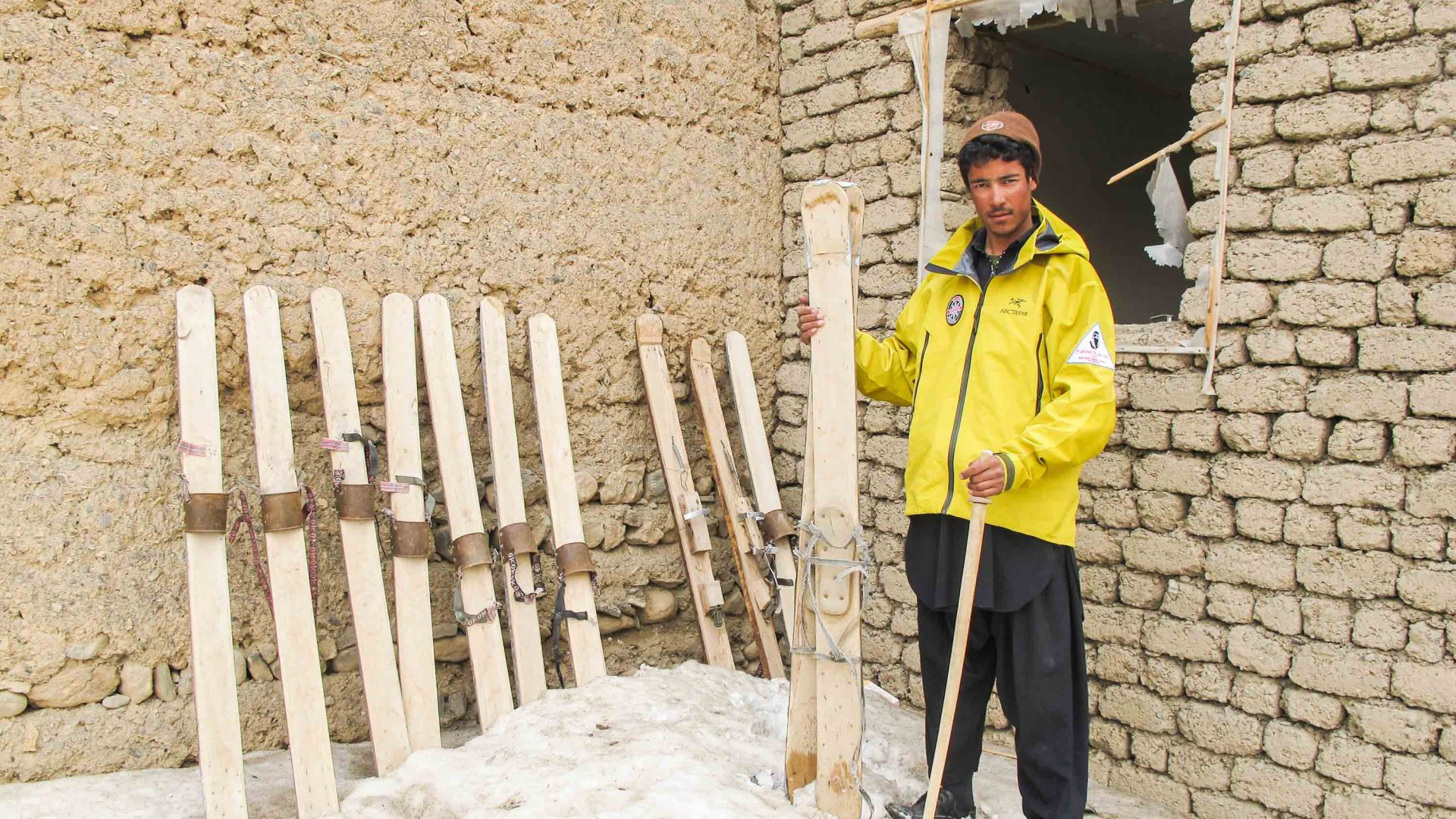 A man shows some of the handmade skis that some of the participants use in the Afghan Ski Challenge.