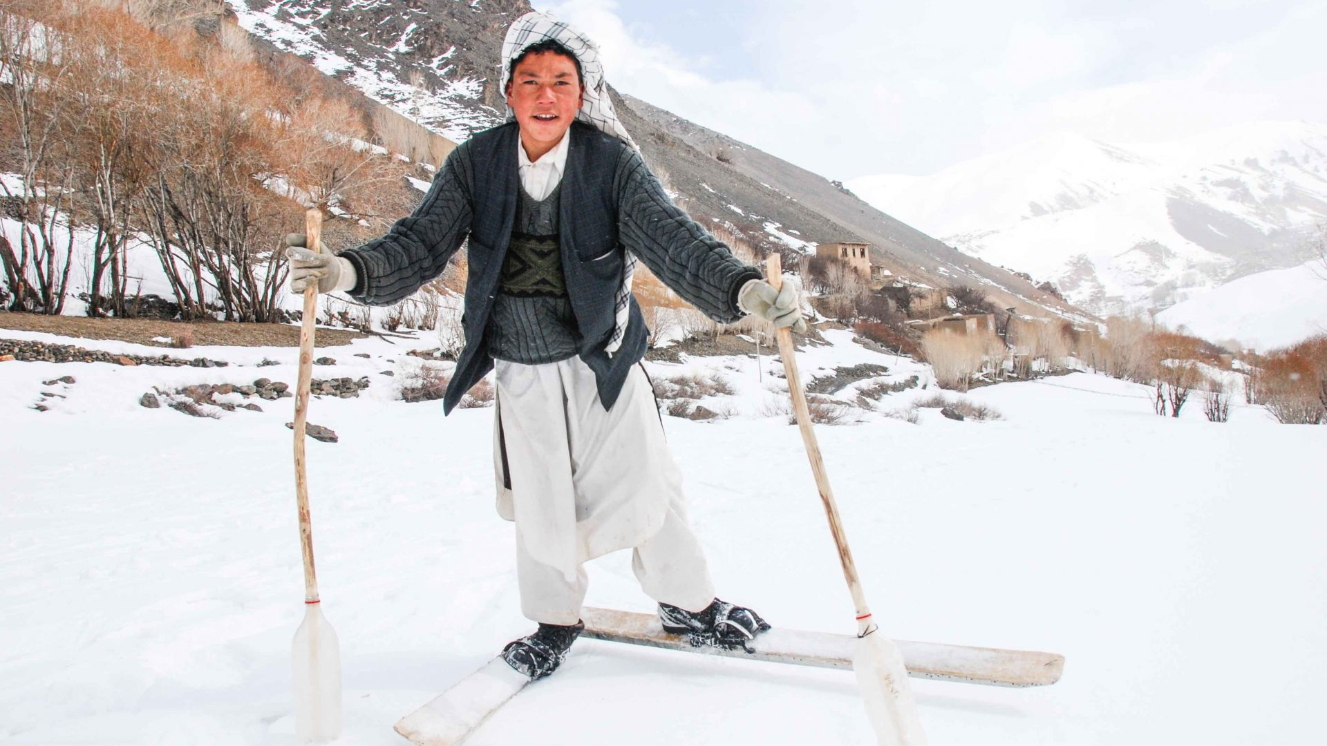 A young Afghani boy makes his way up one of the steep inclines.