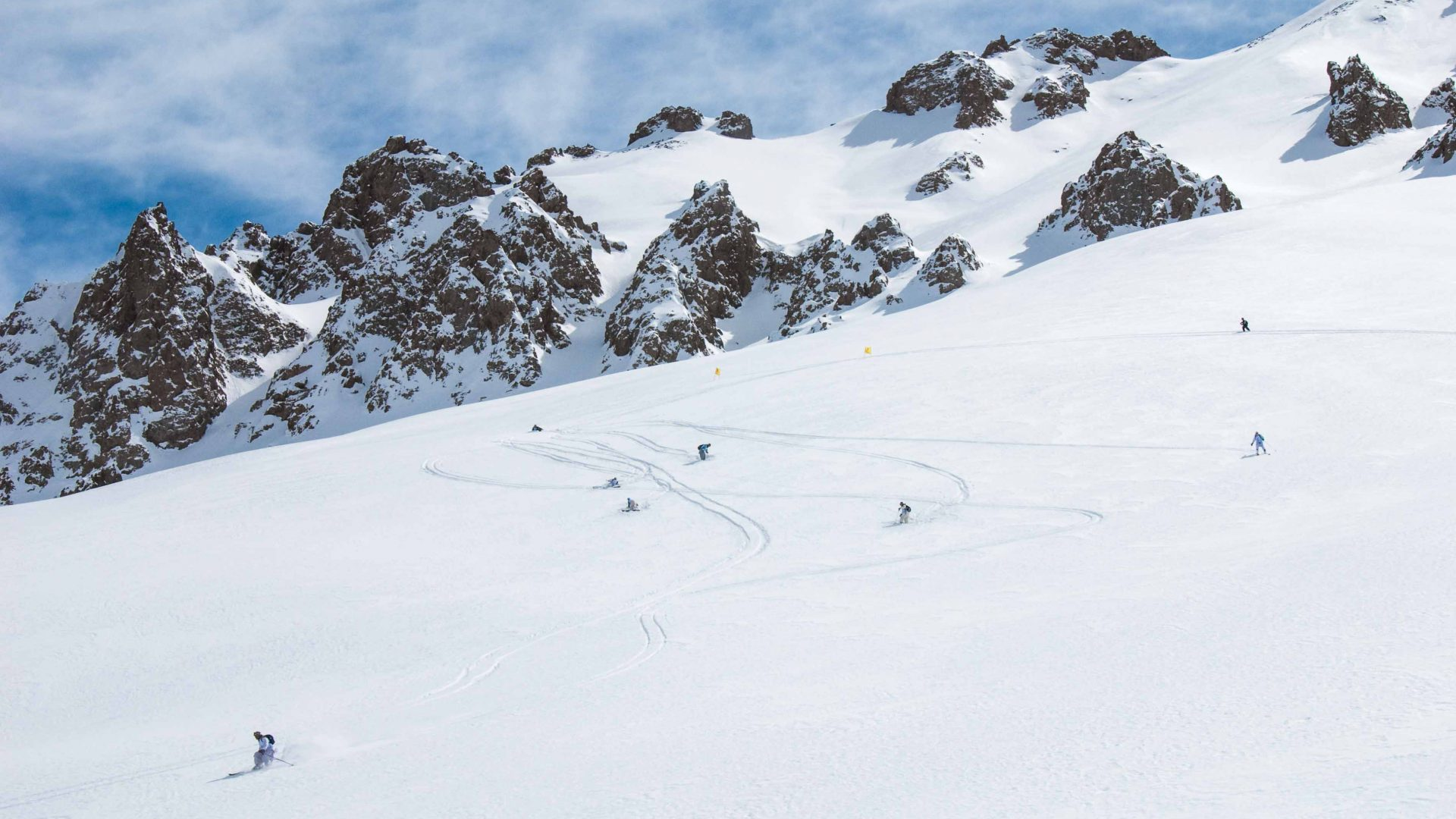 Skiers make their way down big snowy mountains in the Afghan Ski Challenge.
