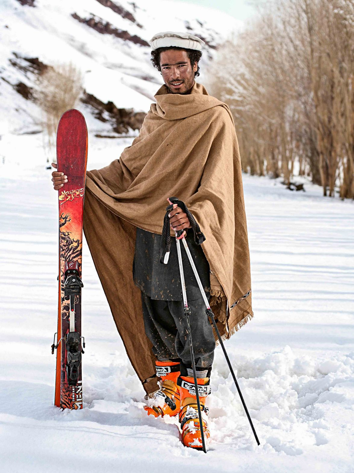 A man poses with his skis at the Afghan Ski Challenge.