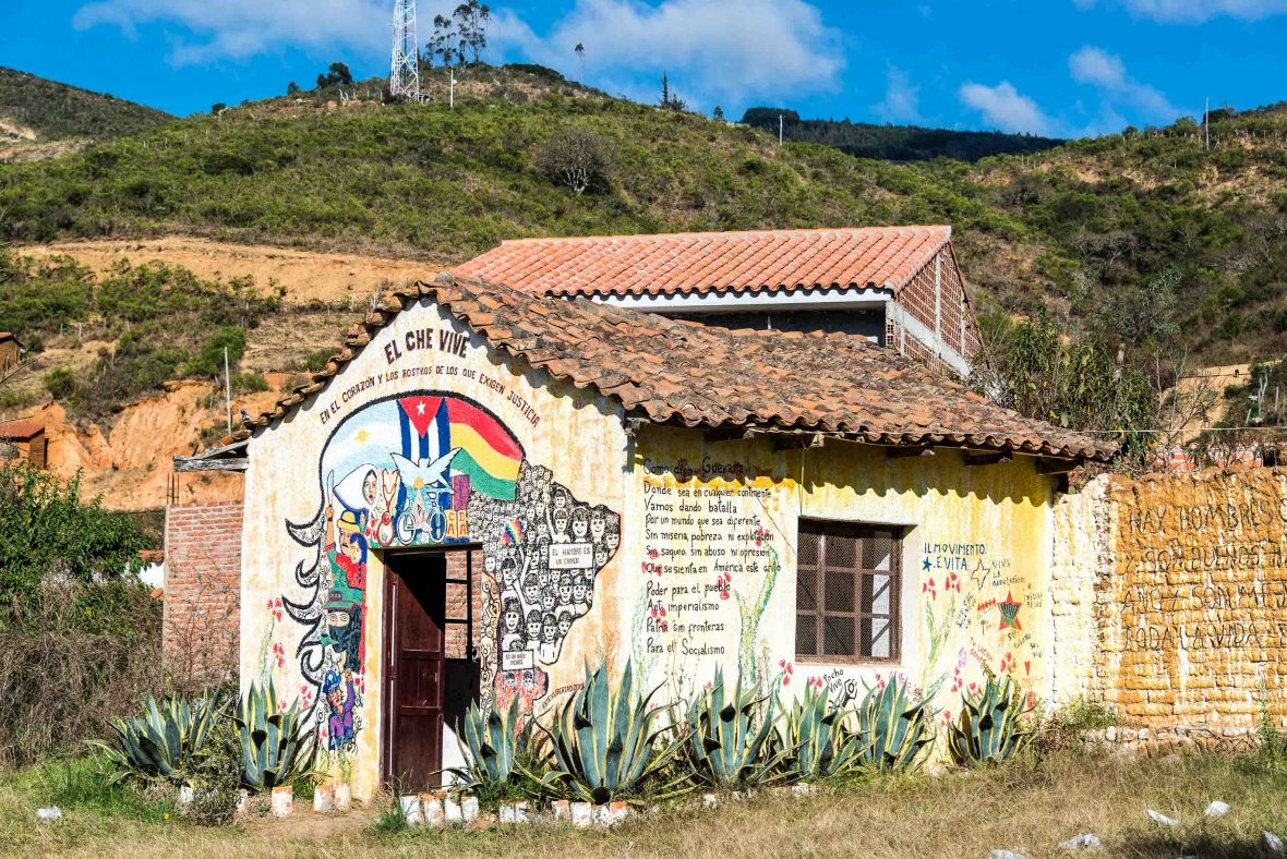 Building with Che Guevara graffiti near the site where his body was publicly displayed in Vallegrande, Bolivia following his death.