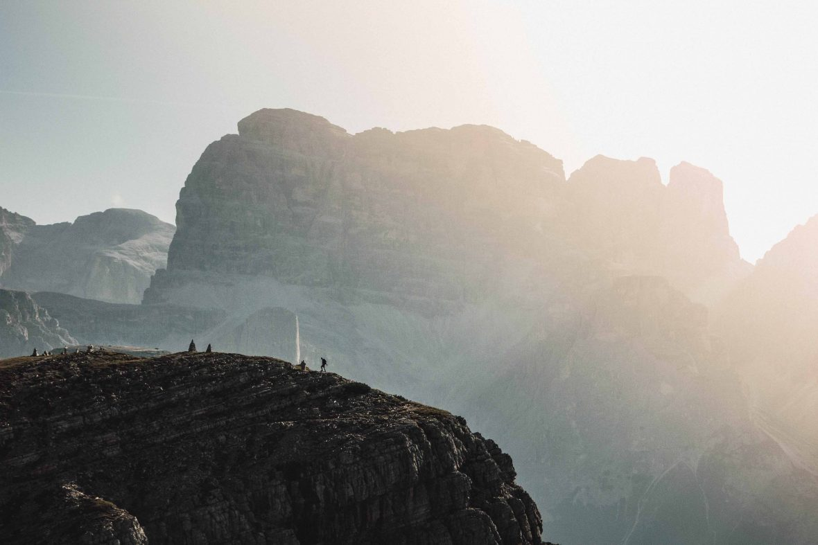 A lone hiker makes their way across the mighty Dolomites in northern Italy.