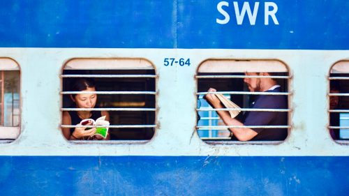 Travelers by train in Kayakumari, India.