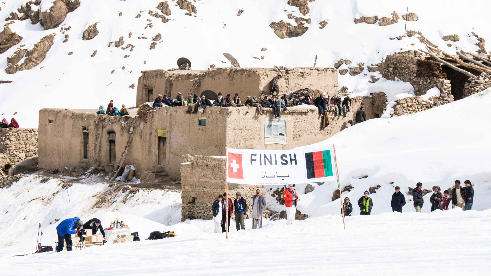 Bystanders ready to see the winners at the finish line of the Afghan Ski Challenge.