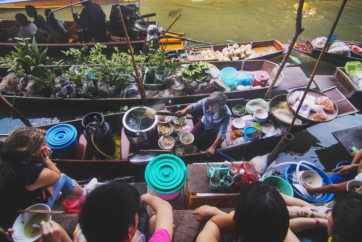 Vendors at a floating market in Bangkok, Thailand.