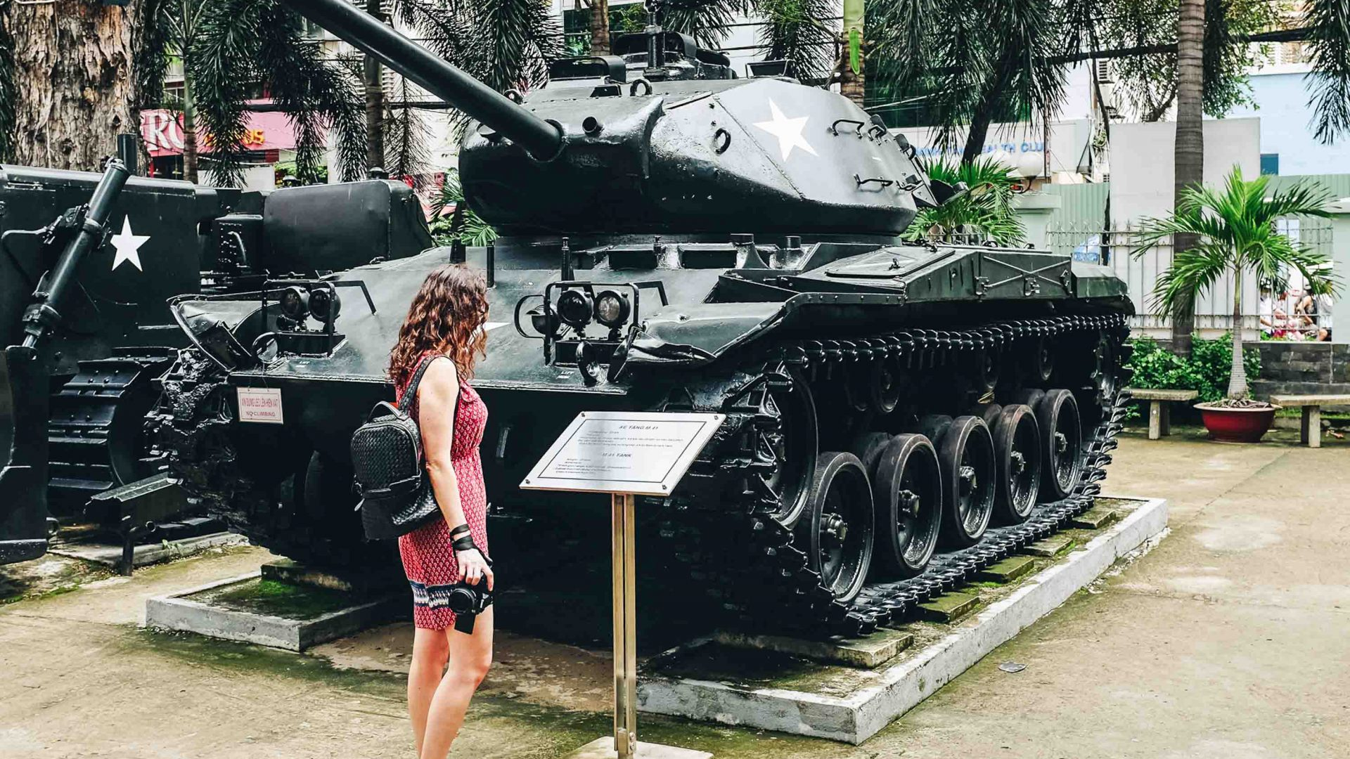 A visitor takes a closer look at an army tank at the War Remnants Museum in Ho Chi Minh City.