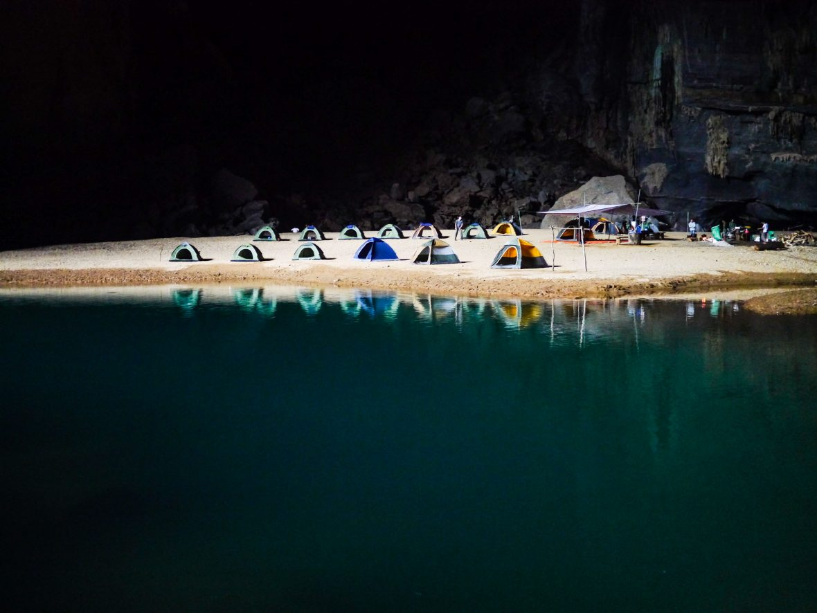 Camping below the limestone karst cliffs in Vietnam.