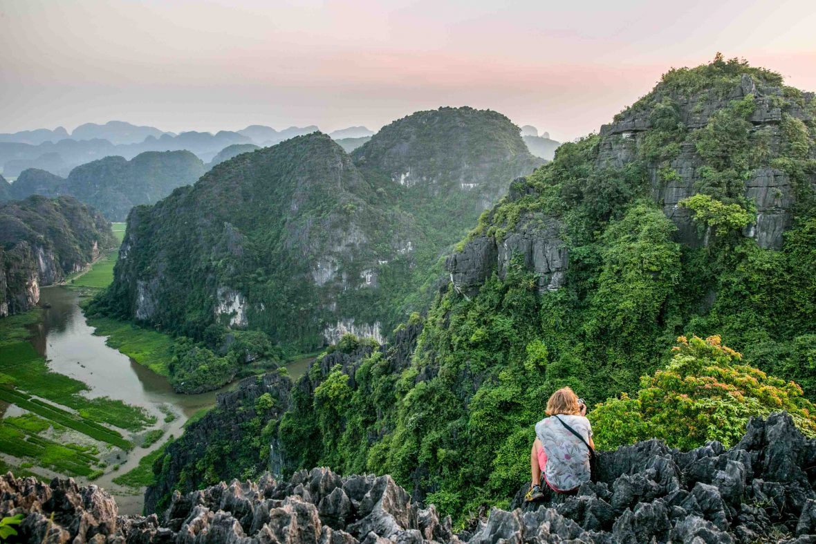 A woman enjoys the sunset views atop Mua Cave in Vietnam's Ninh Binh province.