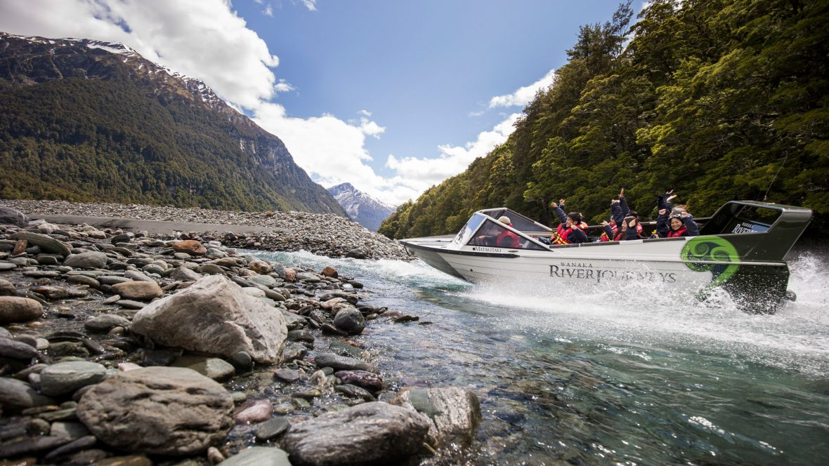 A group jet-boat along the Matukituki River in Wanaka, New Zealand.