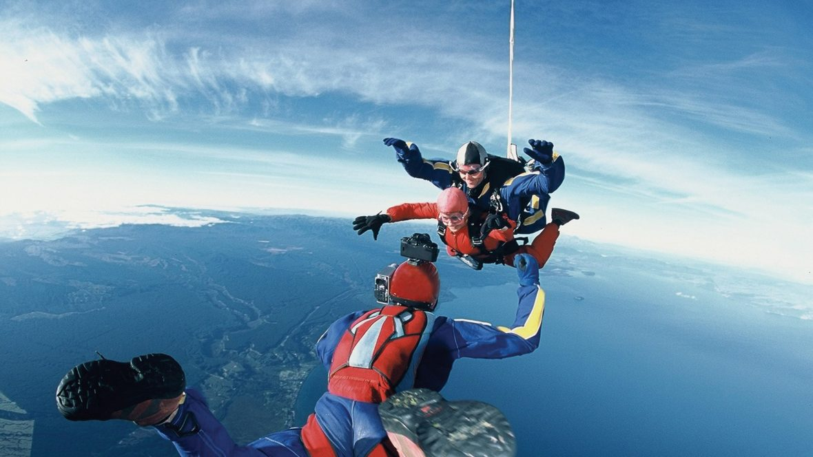 Skydivers plummet over New Zealand's stunning Lake Taupo.