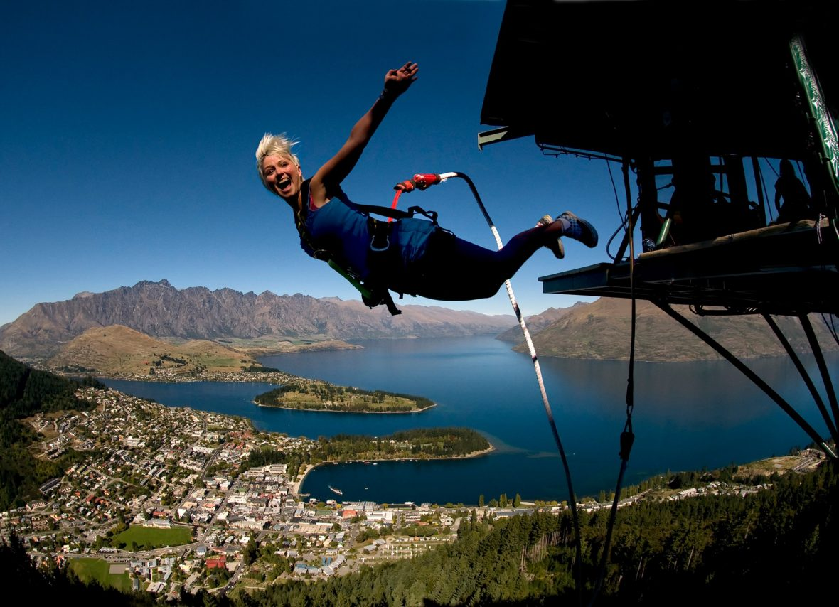 A tourist flings herself into the unknown at AJ Hackett bungy in Queenstown, New Zealand.
