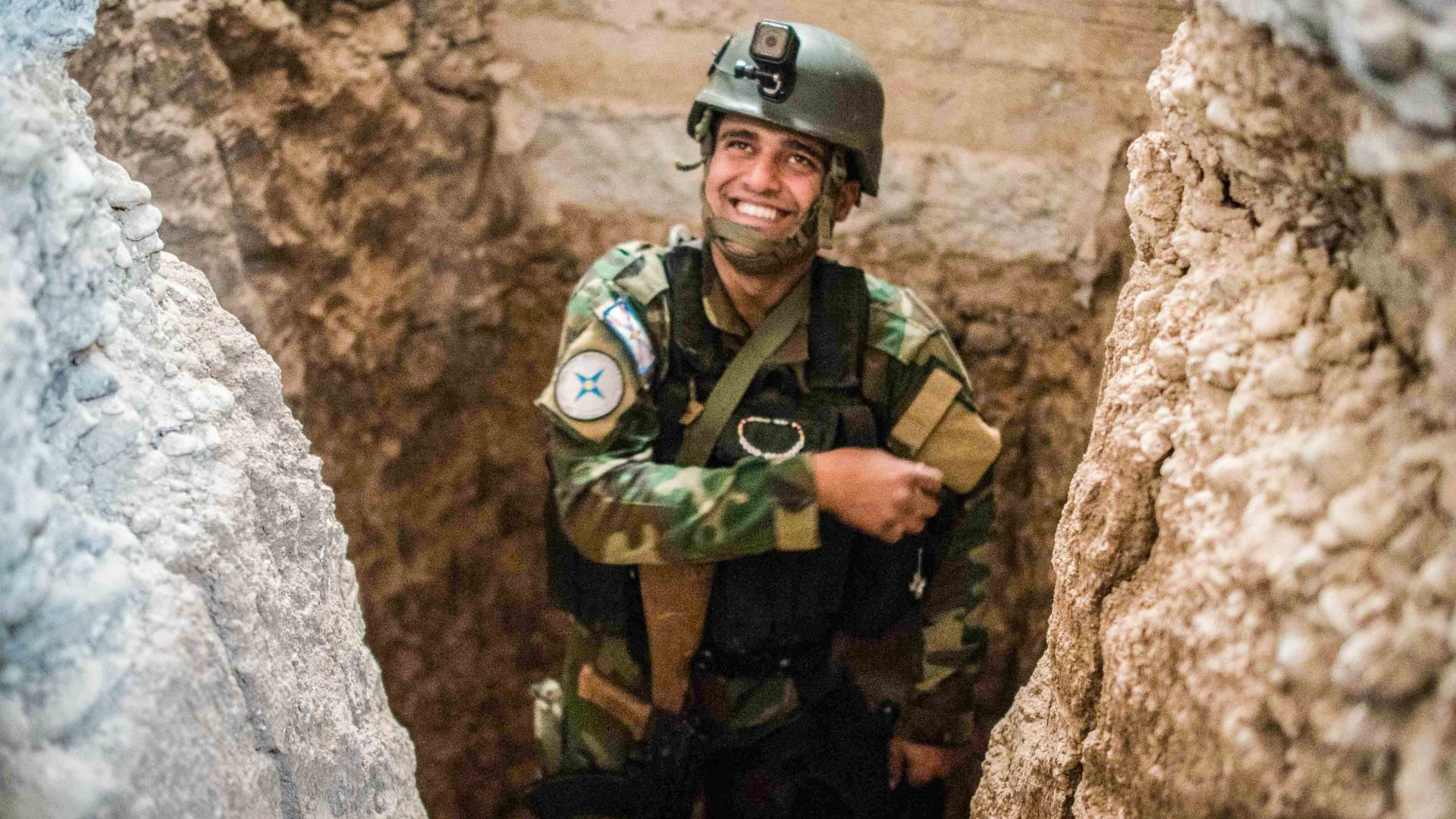 A militiaman inspects a tunnel dug by ISIS fighters in Qaraqosh, Iraq.