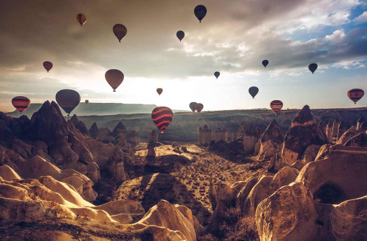 Hot air balloons soar over Cappadocia, Turkey.