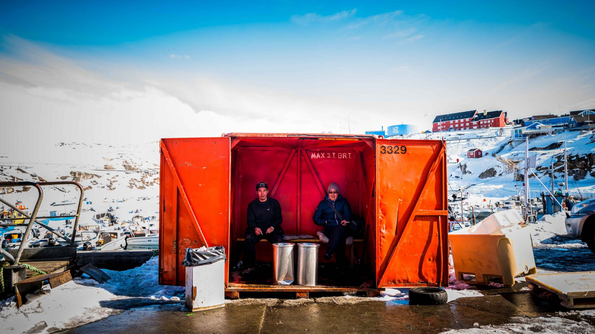 Local fishermen in Ilulissat taking a smoke-break from working at Royal Greenland.