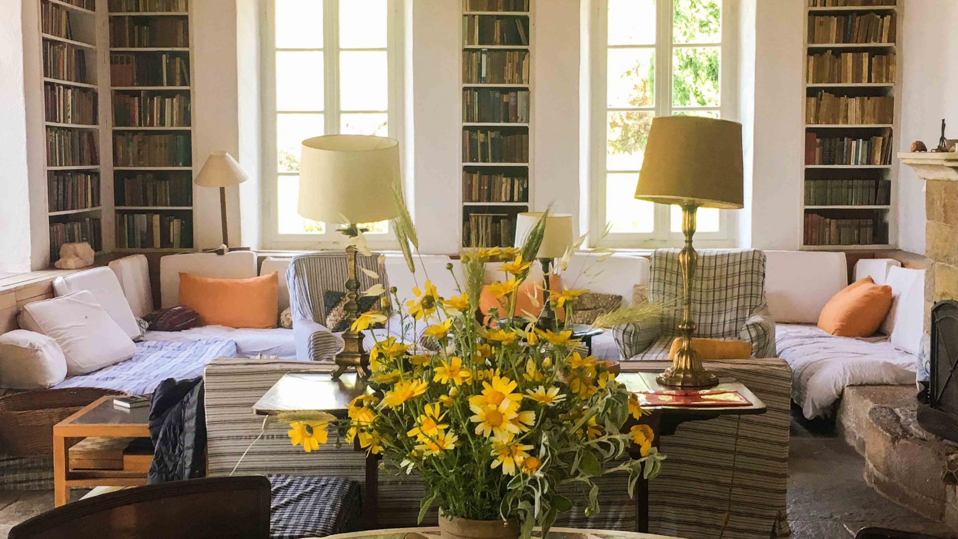 The cosy, book-lined living room at Patrick Leigh Fermor's home.