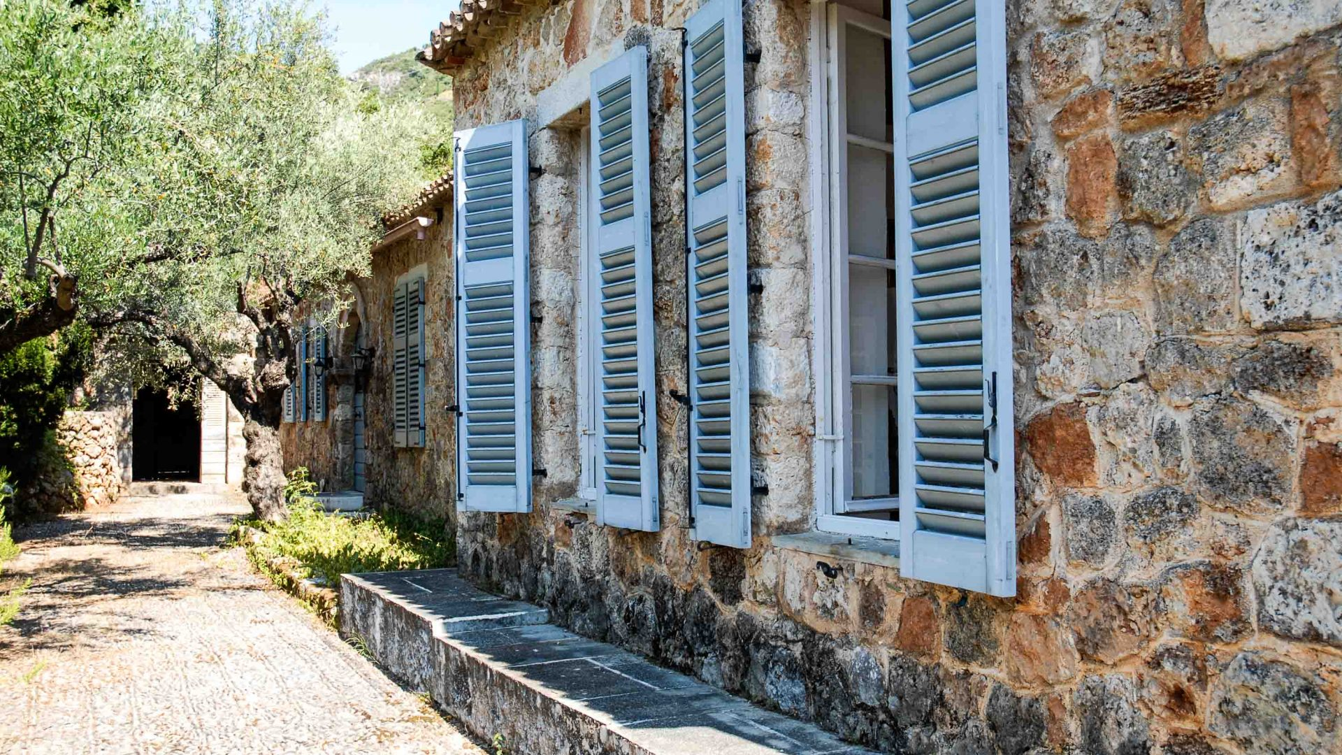 Pretty blue shutters at the home of travel writer Patrick Leigh Fermor in the Mani Peninsula, Greece.