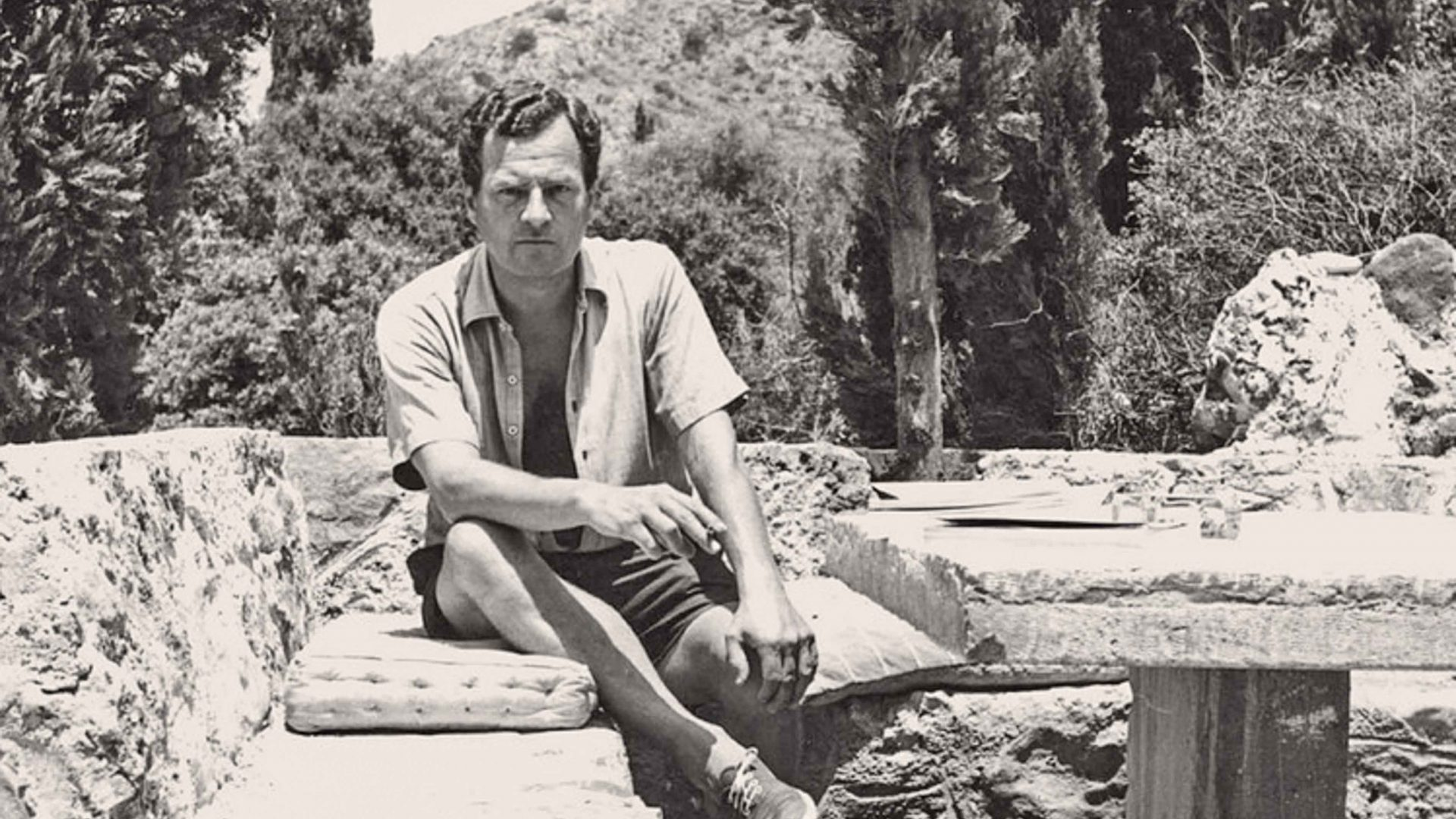 A vintage portrait of Patrick Leigh Fermor outside his home