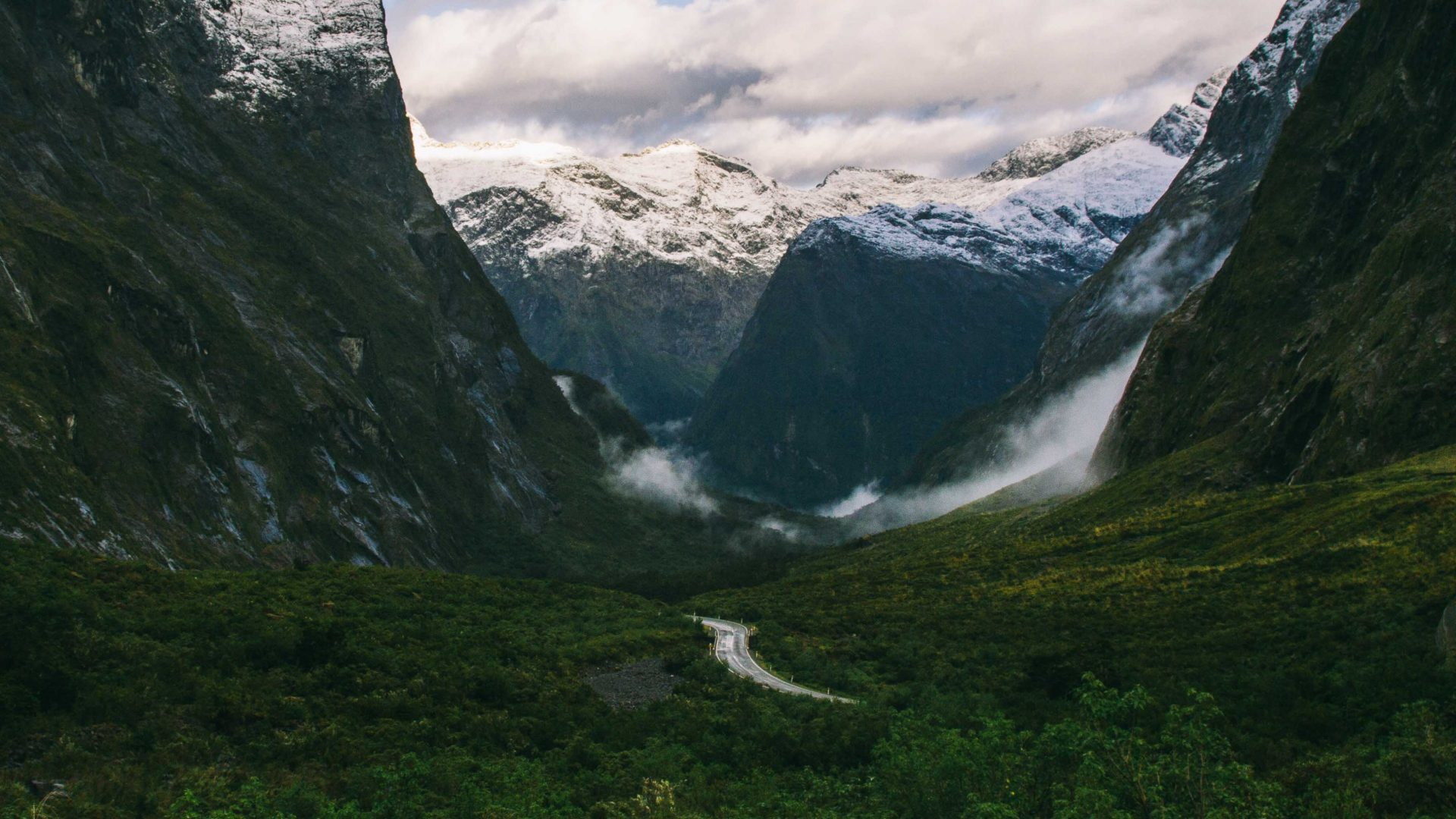 The winding road leading to Homer Tunnel in Fiordland National Park, New Zealand.