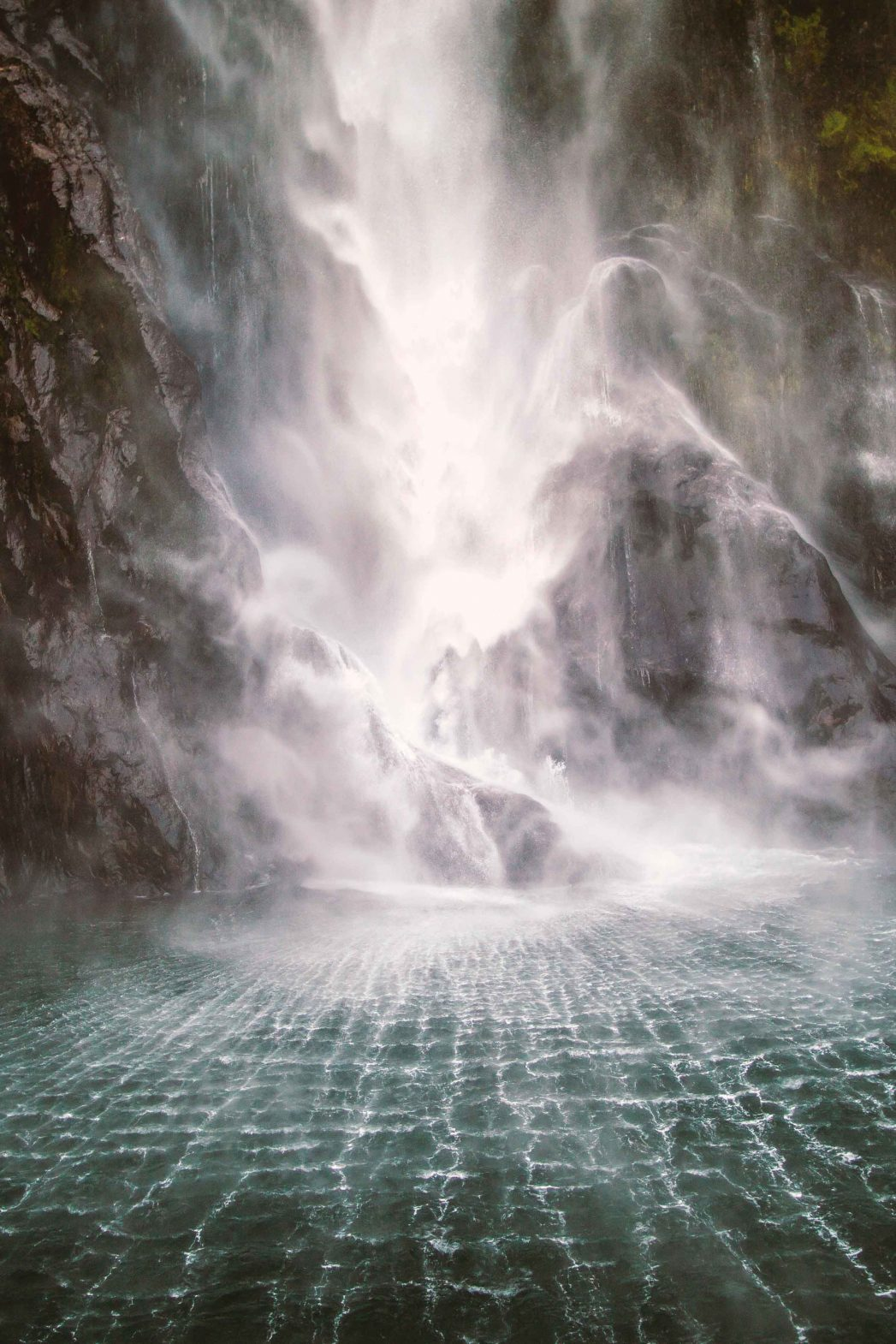 A waterfall at Milford Sound, New Zealand.