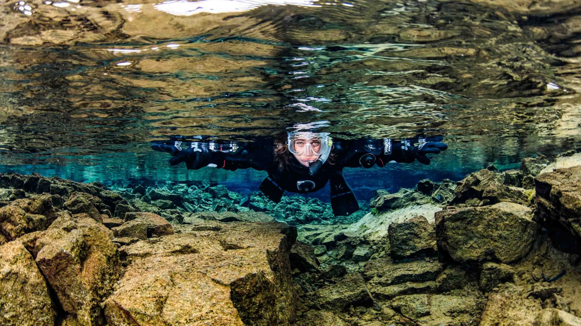 Snorkeling in Iceland's Sifra fissure between two continents.