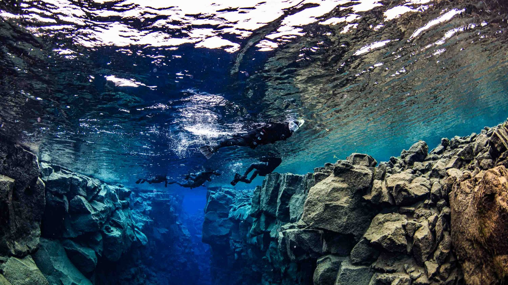 The surreal feeling of snorkeling in a gap between two tectonic plates.