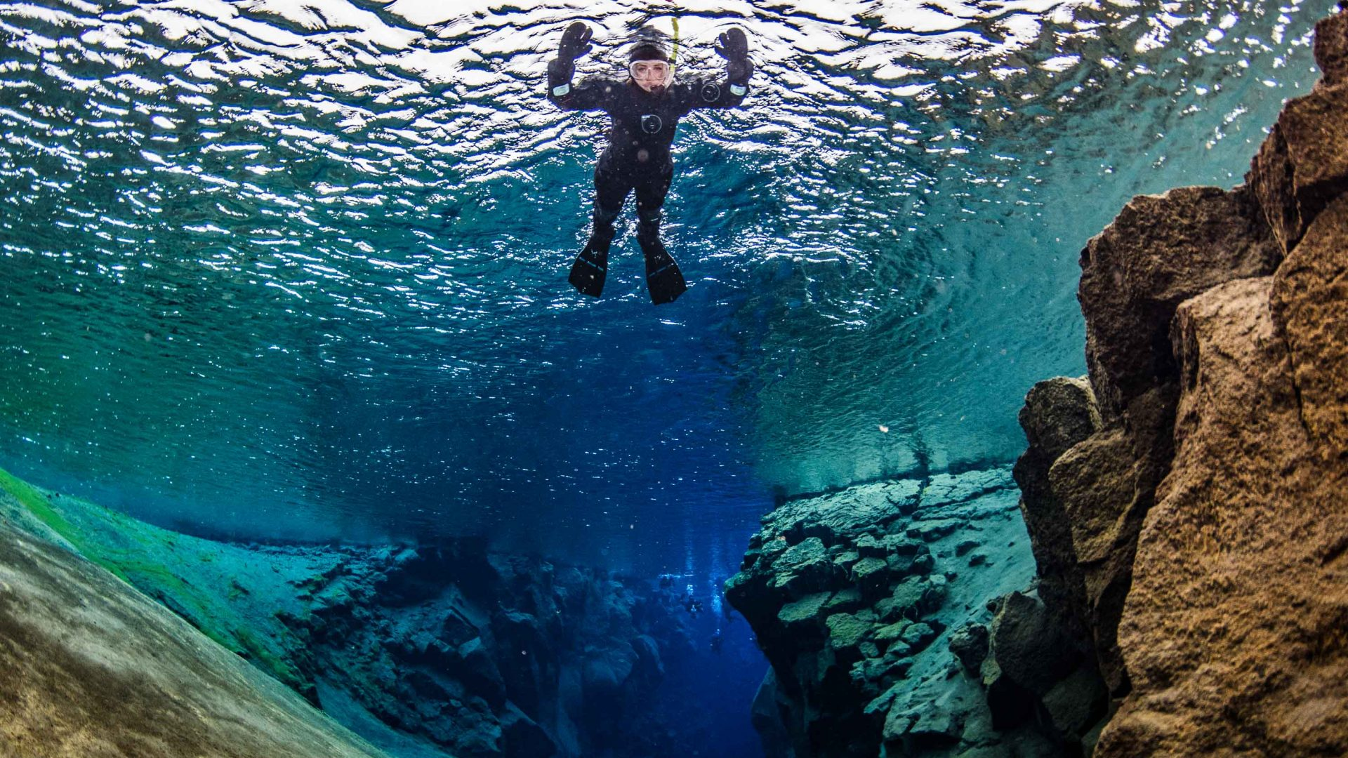 Floating above the Silfra fissure in Iceland.