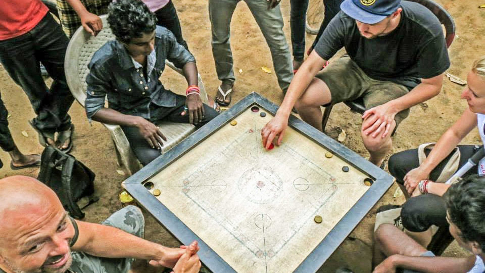 Playing a board game with locals in Sri Lanka.
