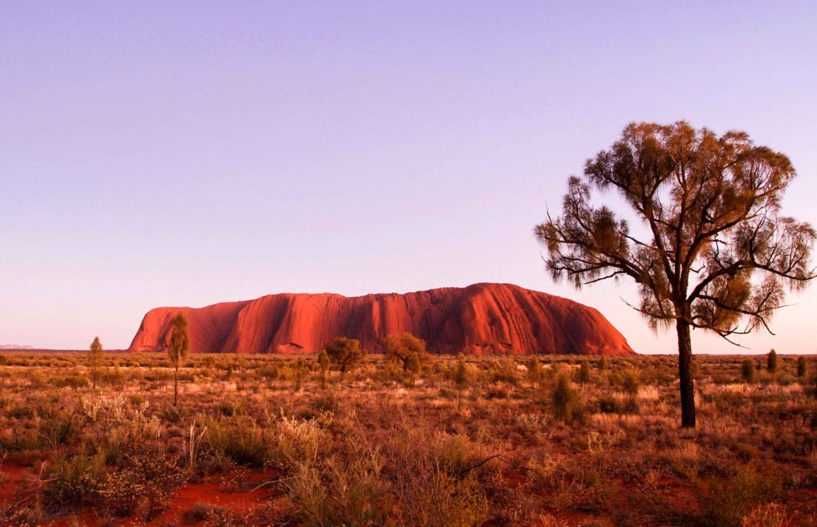 Uluru and Kata Tjuta at sunrise in Uluru-Kata Tjuta National Park.