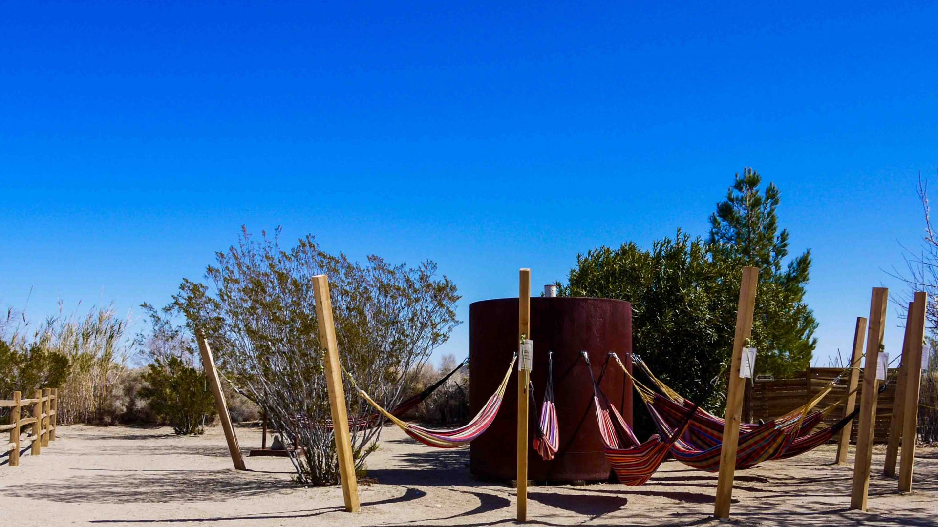 Hammocks where visitors can relax and take in the mystical atmosphere surrounding the Integratron in the Mojave Desert.