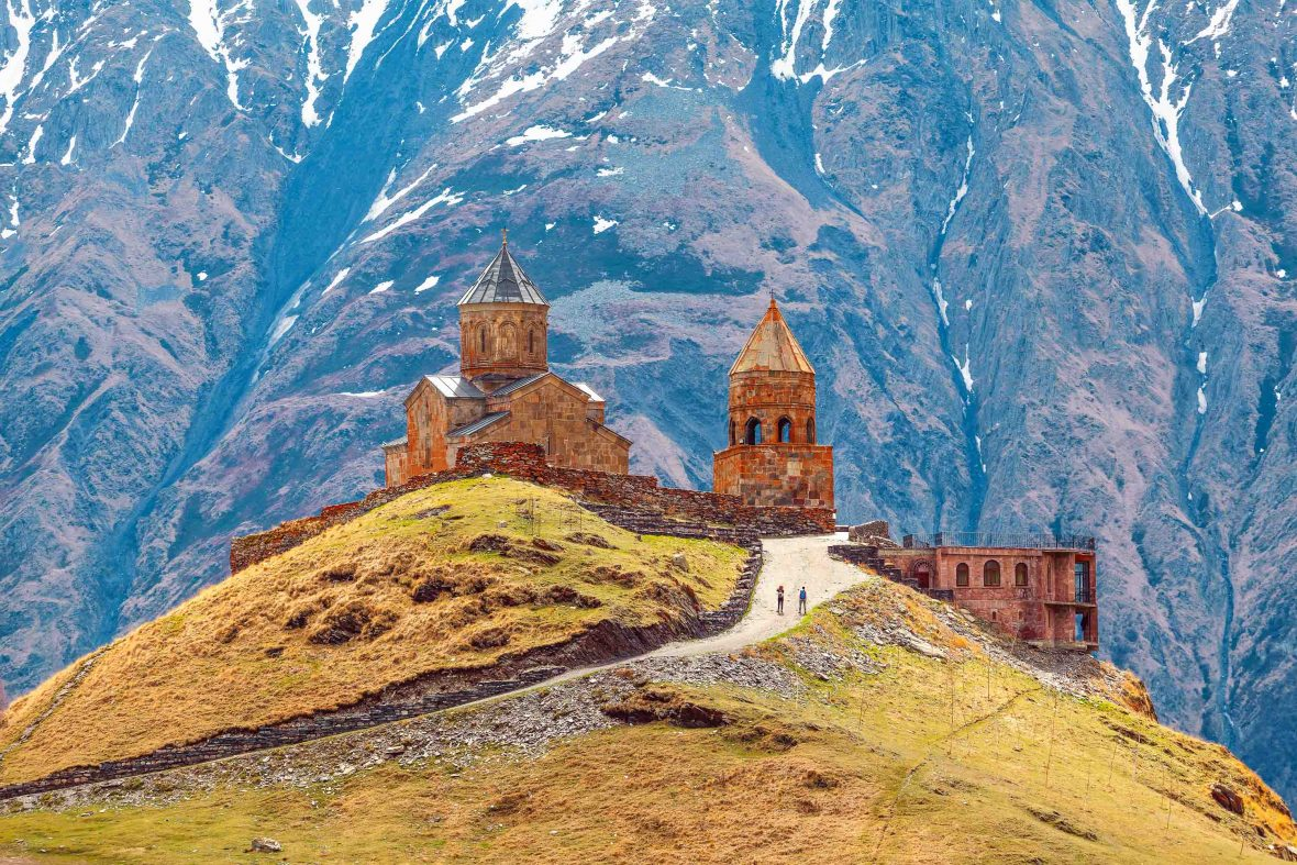 Adventures 2018: A church near Kazbegi in Georgia's beautiful Caucasus Mountains, a region travelers can explore on foot with Walks Worldwide in 2018.
