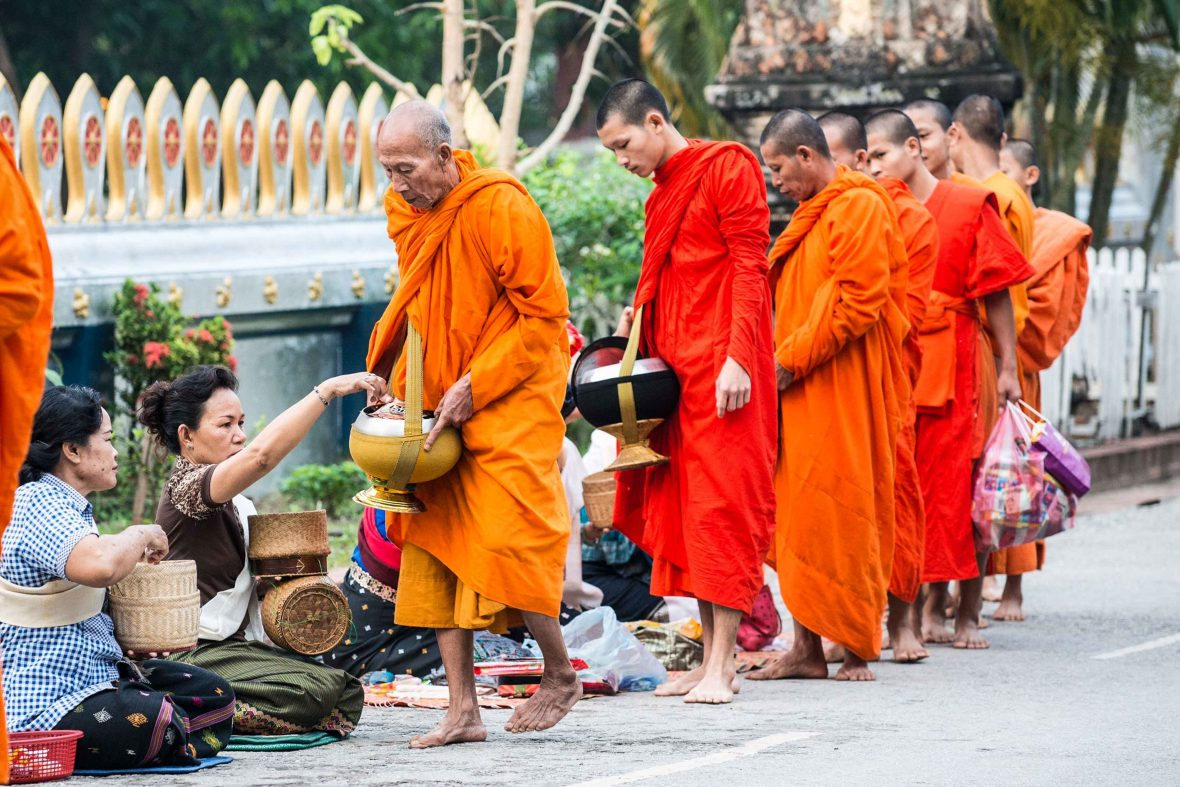While many Asian cultures have a tradition of giving—like the buddhist monks of Luang Prabang, Laos—the notion that western backpackers are doing it to fund travel, has many people outraged.