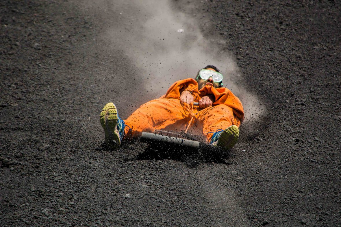 A man goes volcano-boarding in the Cerro Negro of Nicaragua.
