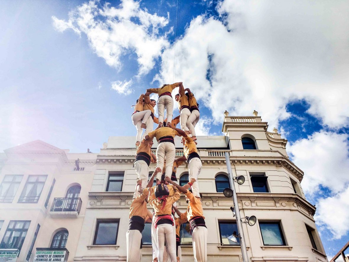 A human tower of people, known as castellers, in Barcelona, Catalunya.