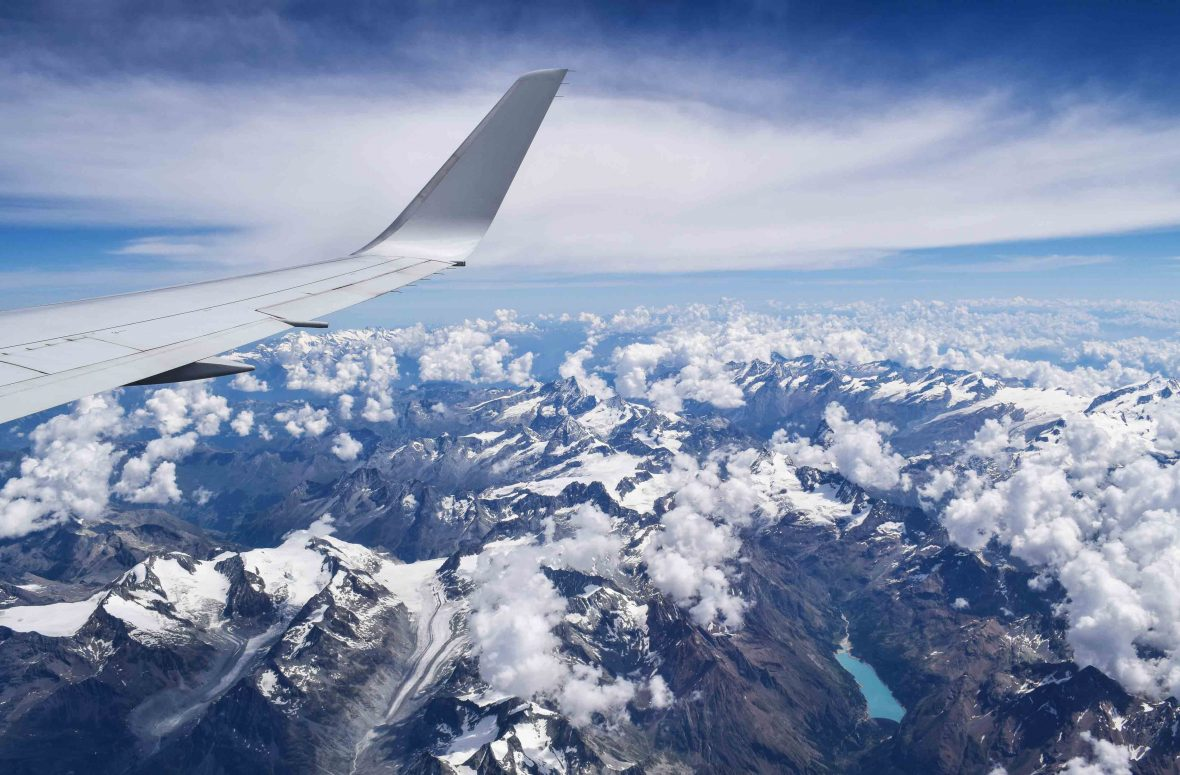 An airplane flies over the Alps.