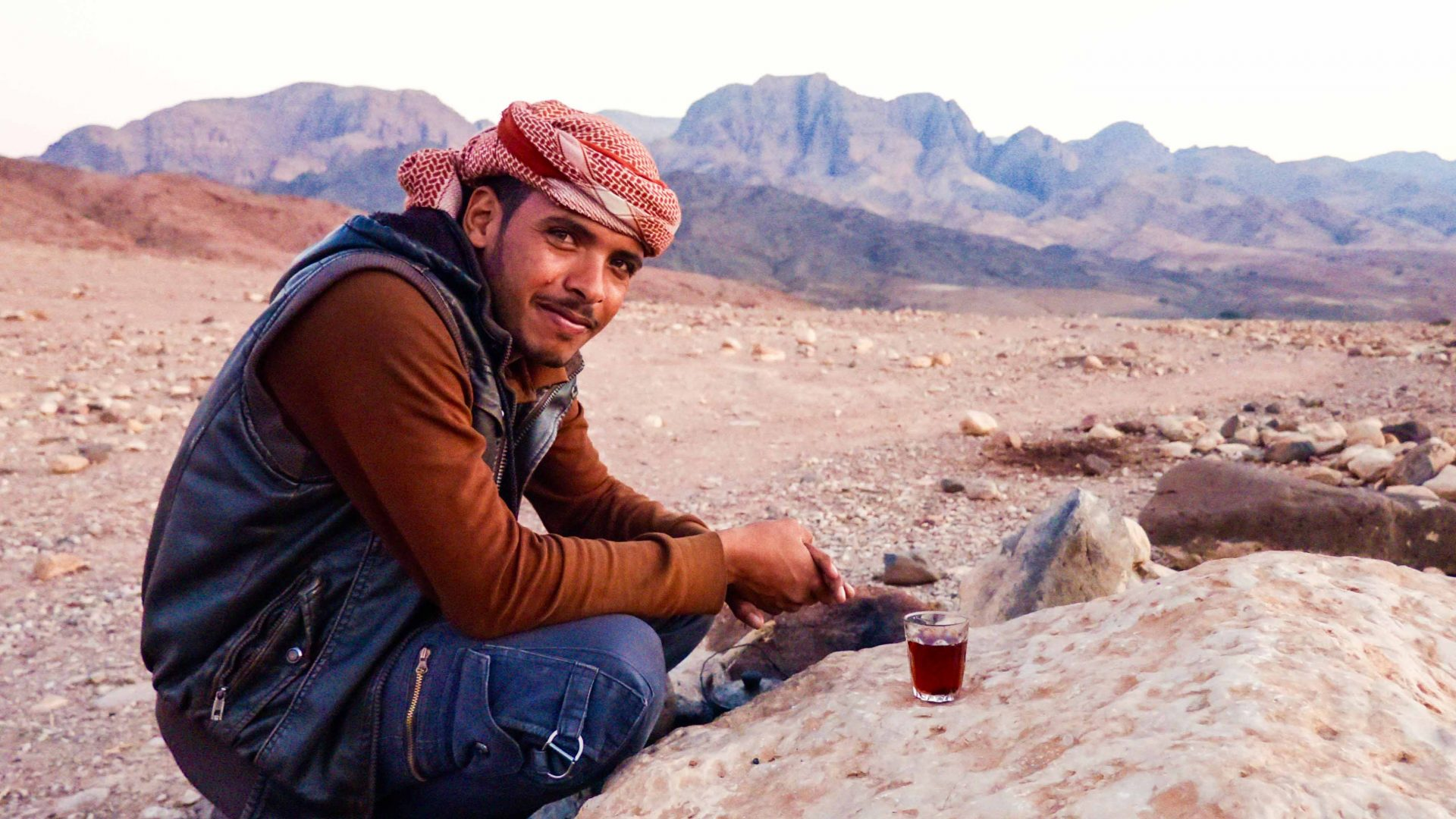 Meeting locals on your travels: a local man drinks tea in Jordan.