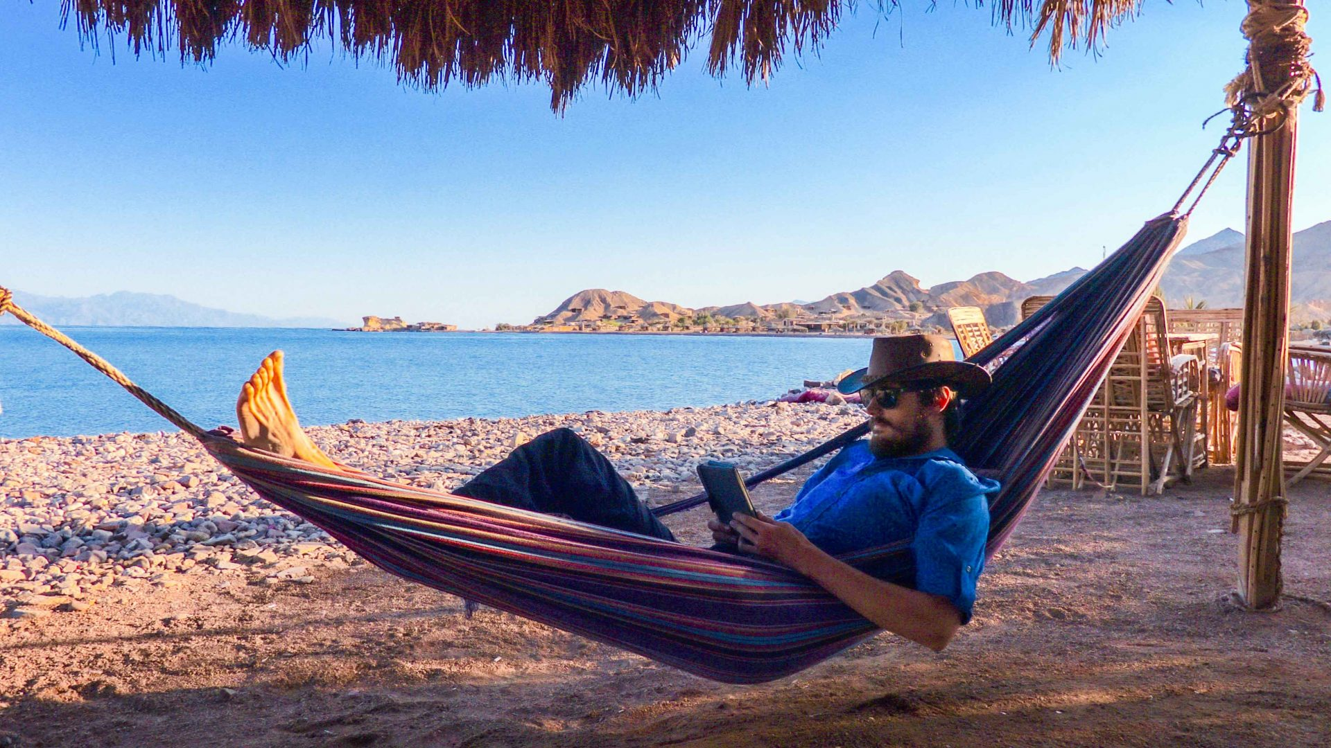 Leon McCarron relaxes in a hammock on a Sinai beach in Egypt.