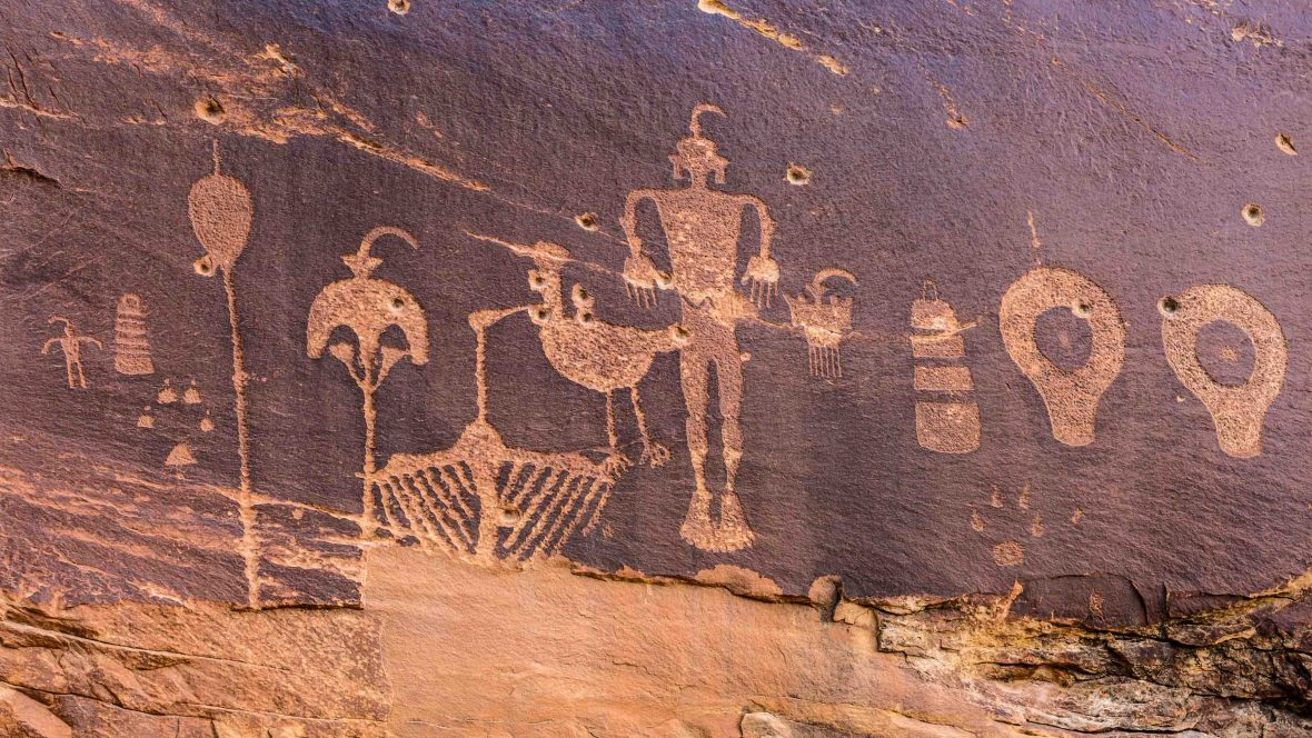 A petroglyph panel showing a variety of humanoid and animal images portrayed on the cliffs of Butler Wash in the Comb Ridge aea of the new Bears Ears National Monument.