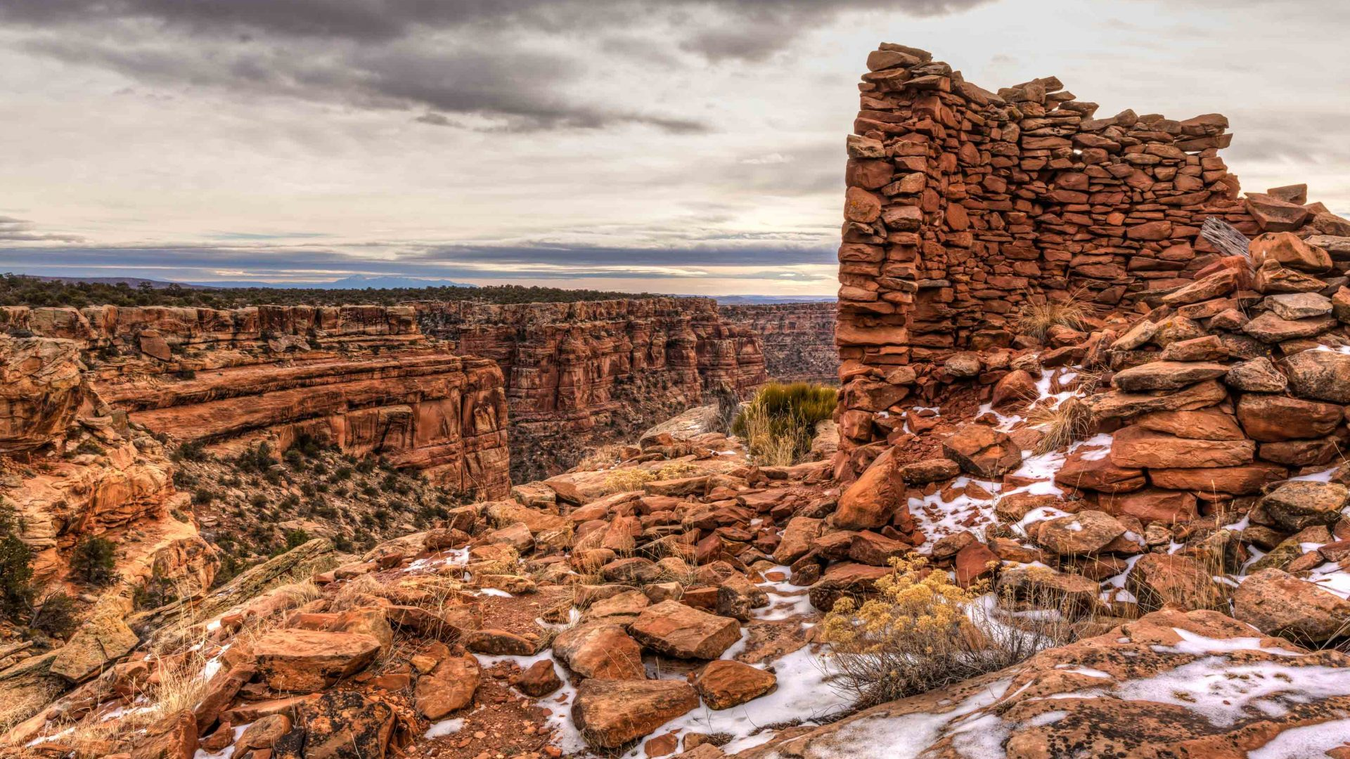Snow-covered remnants of an Anasazi tower ruin on the rim of Mule Canyon in the Cedar Mesa area of Bears Ears National Monument, Utah.