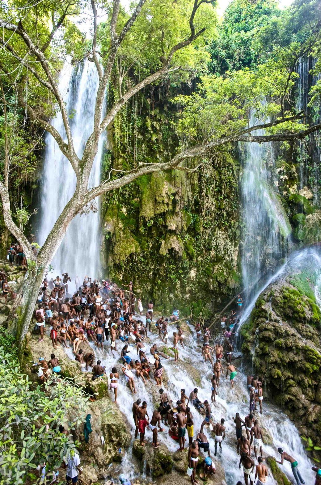 Crowds of Vodou practitioners worship beneath the Saut d'Eau waterfall during a Vodou festival in Haiti.