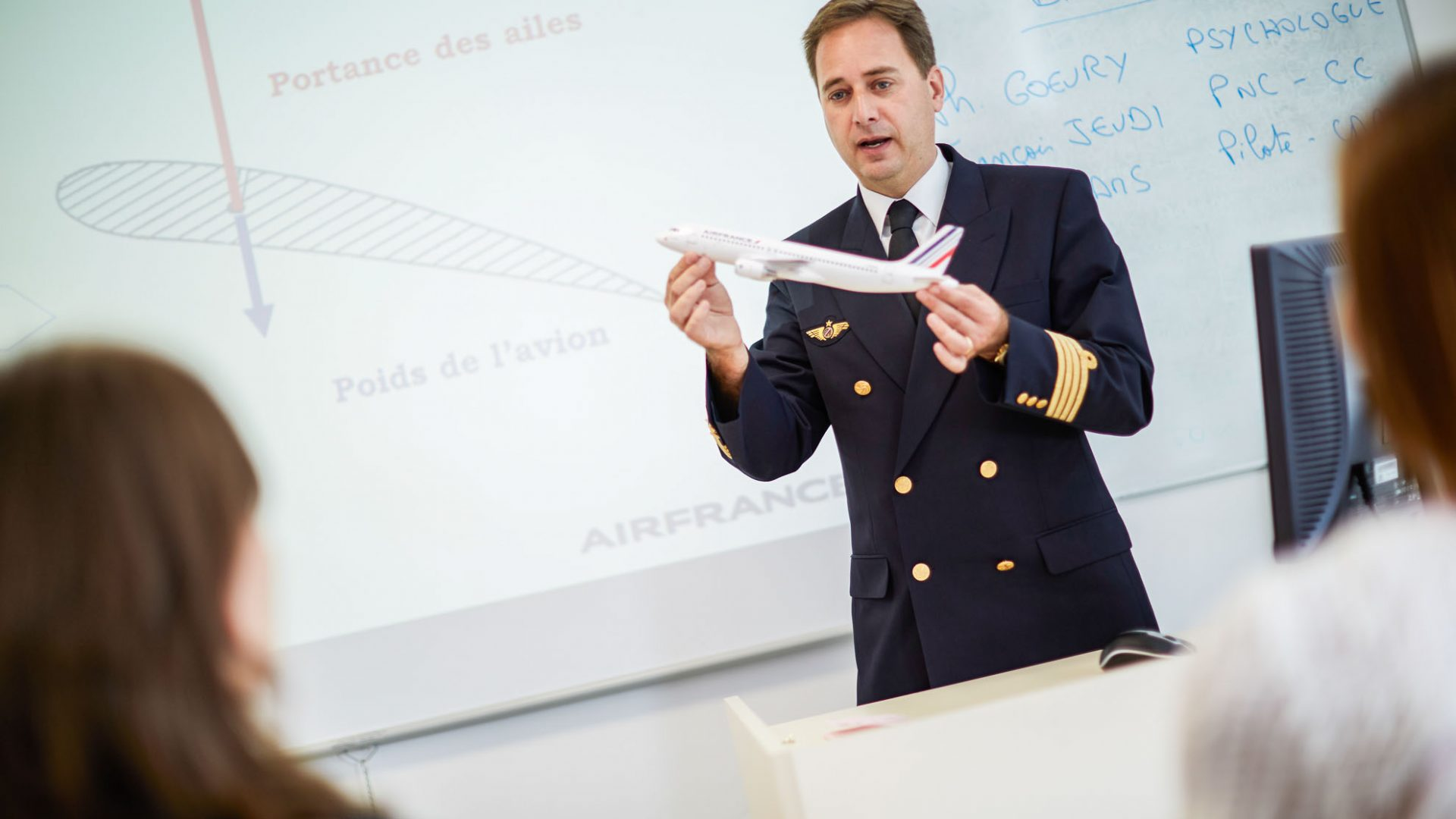 People participate in an Air France anti stress workshop to help them overcome a fear of flying.