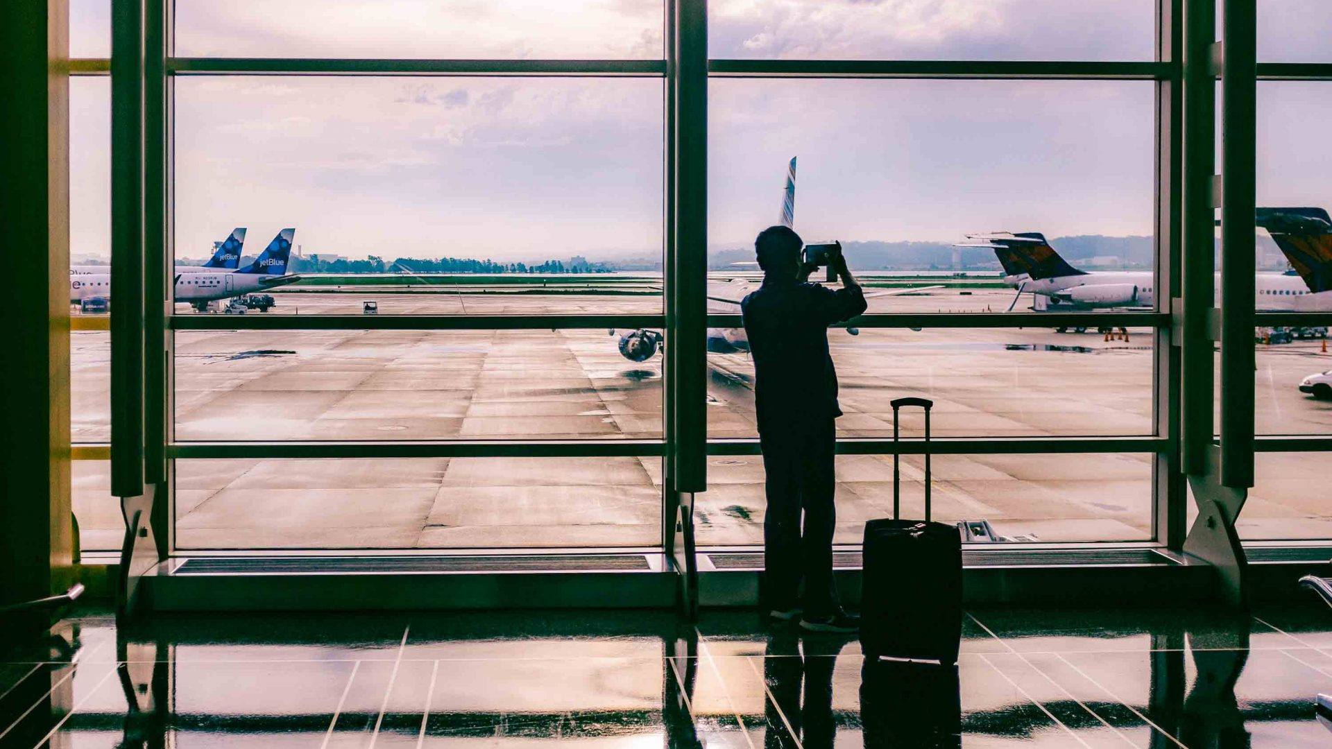 Flying phobia: A man looks out at the airplanes at an airport.